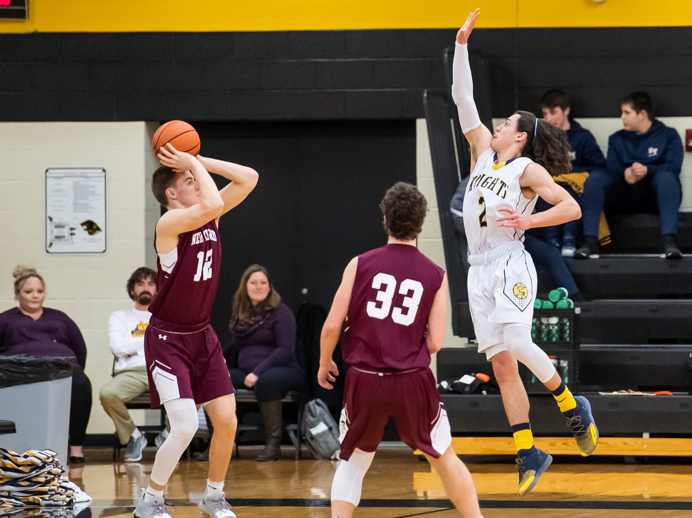 """New Oxford's Brayden Long shoots a corner three during play against Eastern York in a YAIAA quarterfinal game at Red Lion High School Saturday, February 9, 2019. The Colonials won 54-44. Long scored 15 points in the win. """"(Long) had been in a little bit of a slump,"""" New Oxford head coach Sean Bair said. """"I was very happy to see him get that going, but we know he's got that in him."""""""