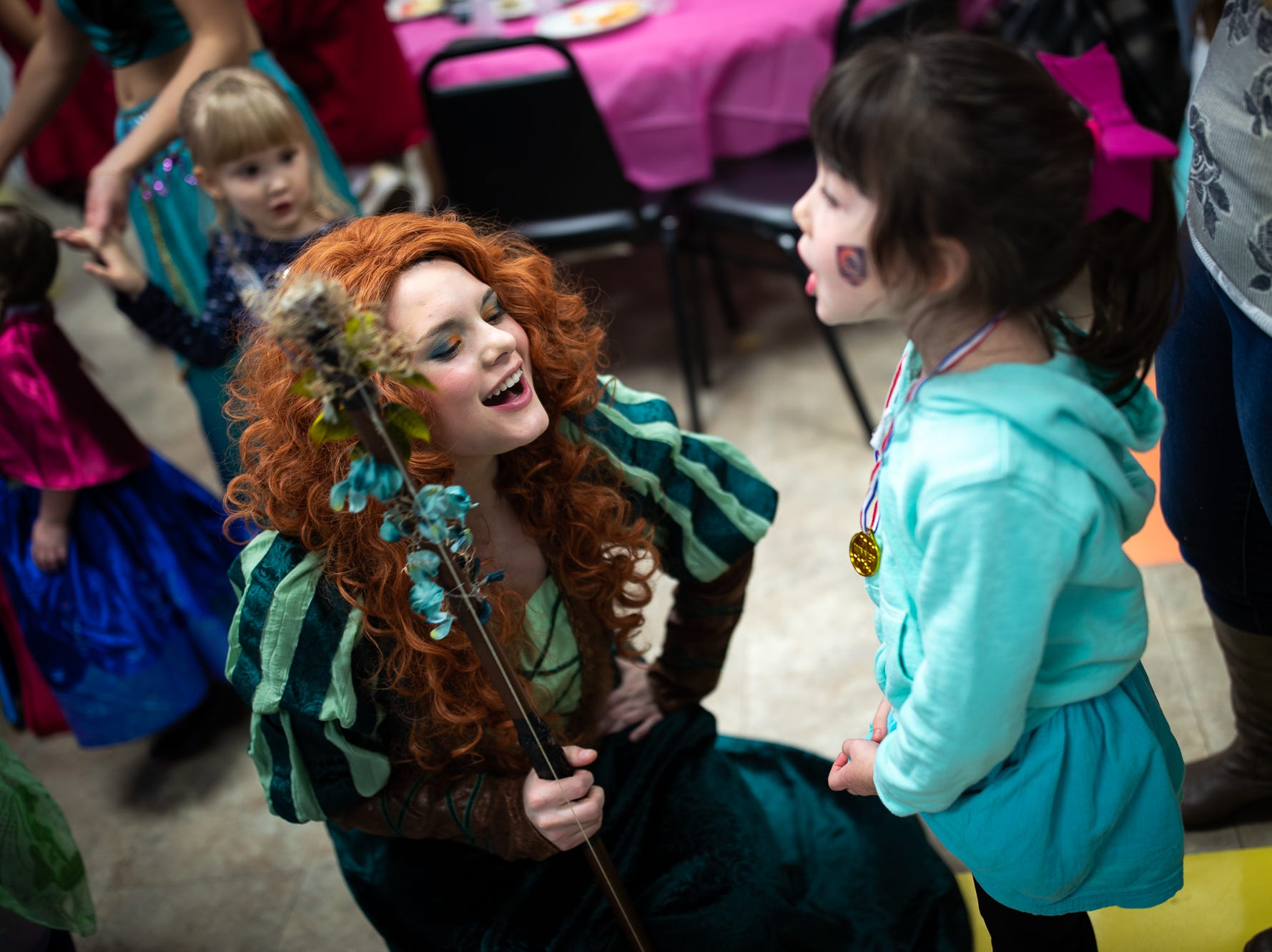 Princess Merida sings along with kids during a princess teatime hosted by the Black Rose Rollers, Saturday, Feb. 9, 2019, at the Hanover YWCA.