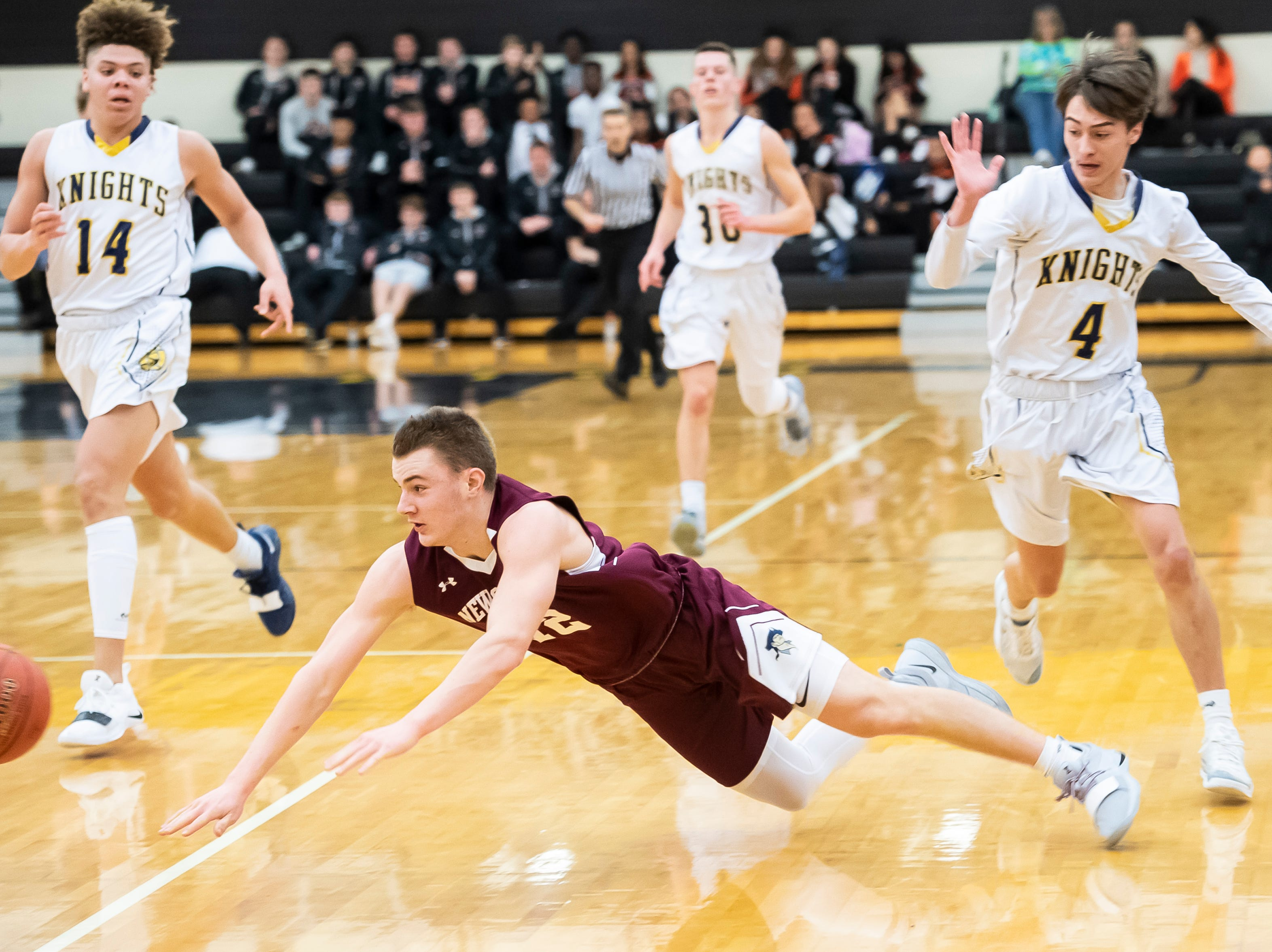 New Oxford's Brayden Long slips while driving down the court during play against Eastern York in a YAIAA quarterfinal game at Red Lion High School Saturday, February 9, 2019. The Colonials won 54-44.