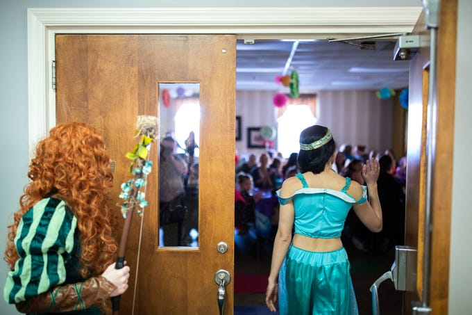 Members of the Black Rose Rollers, dressed as Disney princesses, make their entrance during a princess teatime event, Saturday, Feb. 9, 2019, at the Hanover YWCA.
