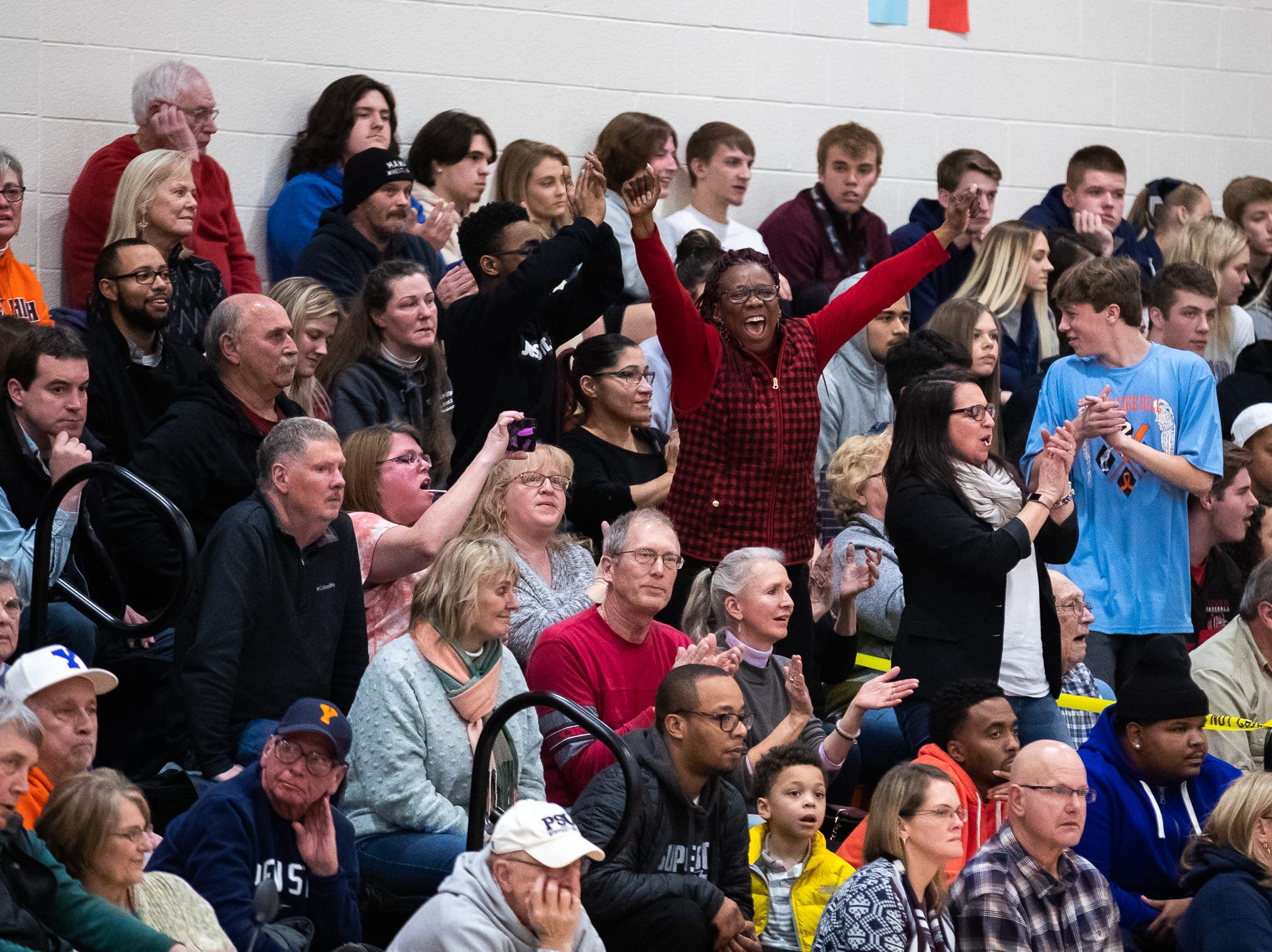 The Dover fan section cheers during the first half of a YAIAA quarterfinal between York High and Dover, Saturday, Feb. 9, 2019, at Central York High School. West York led Dover 48-35 at the half.