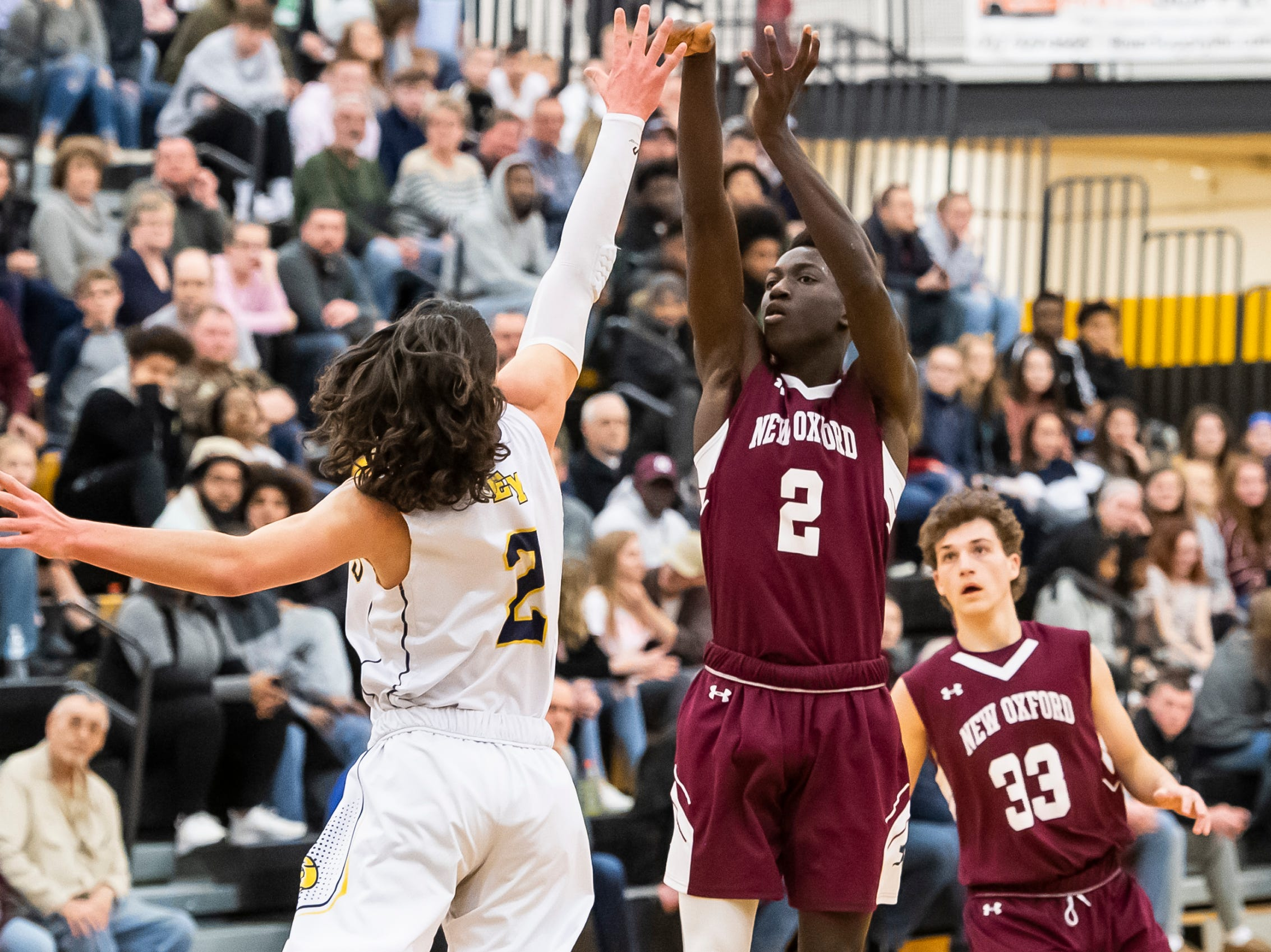 New Oxford's Abdul Janneh take a 3-point shot during play against Eastern York in a YAIAA quarterfinal game at Red Lion High School Saturday, February 9, 2019. Janneh led all players with 20 points.