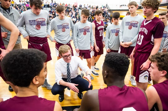 New Oxford head coach Sean Bair talks with his team before the start of the second quarter against Eastern York in a YAIAA quarterfinal game at Red Lion High School Saturday, February 9, 2019.