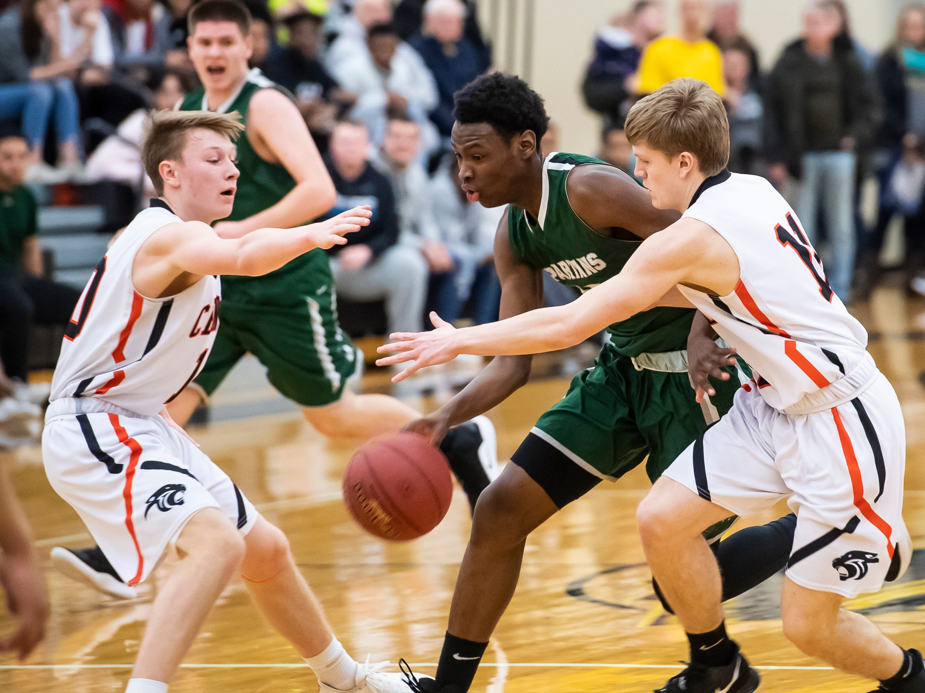 York County Tech's Jahkwan Batty dribbles between two Central York defenders in a YAIAA quarterfinal game at Red Lion High School Saturday, February 9, 2019. The Panthers won 74-43.