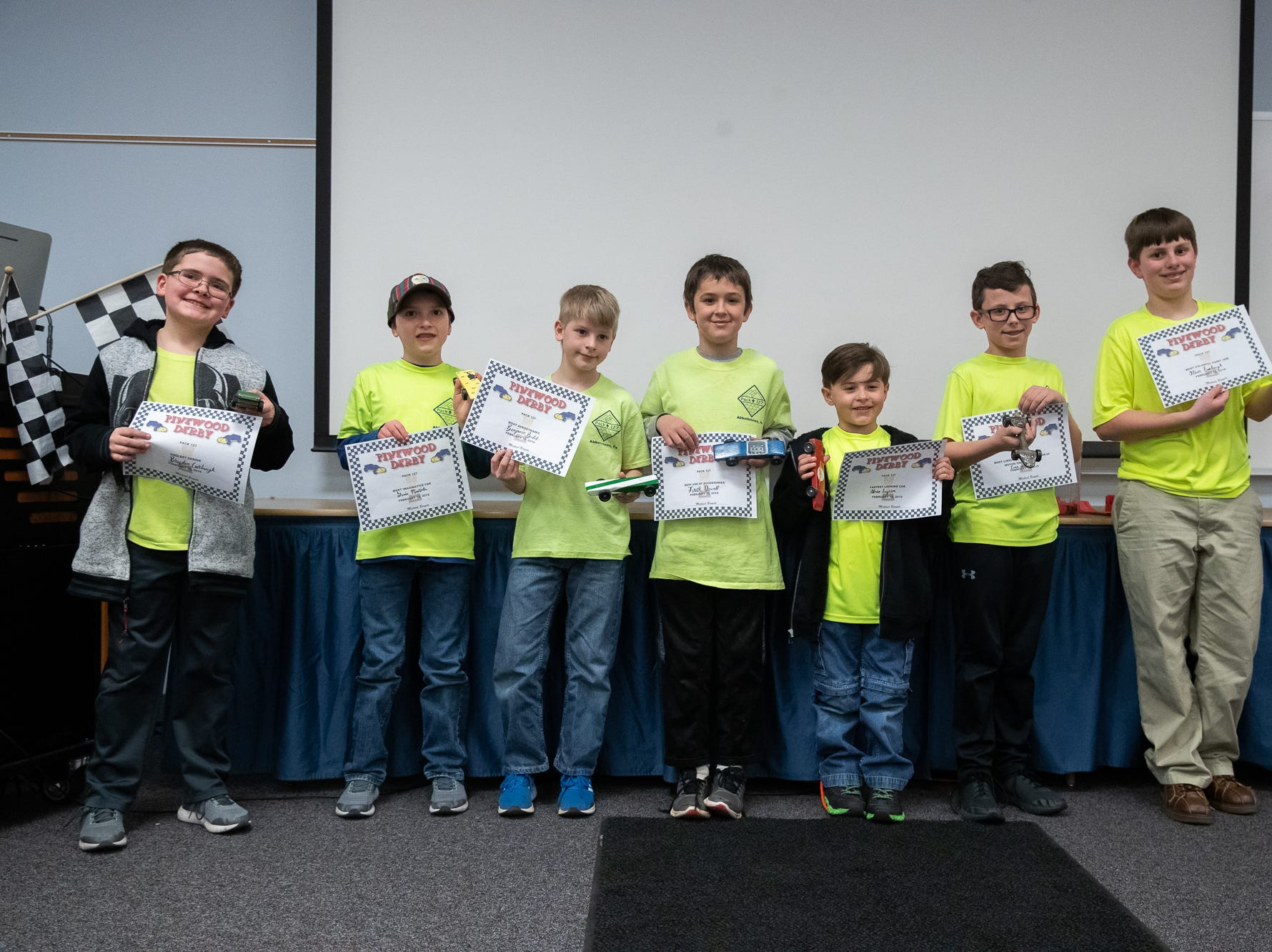 Cub scouts pose with awards for their custom cars during the cub scouts pack 127 Pinewood Derby event at Lincoln Intermediate Unit 12, Sunday, Feb. 10 in New Oxford. The scouts had a month to design their custom pinewood cars to race in the event.