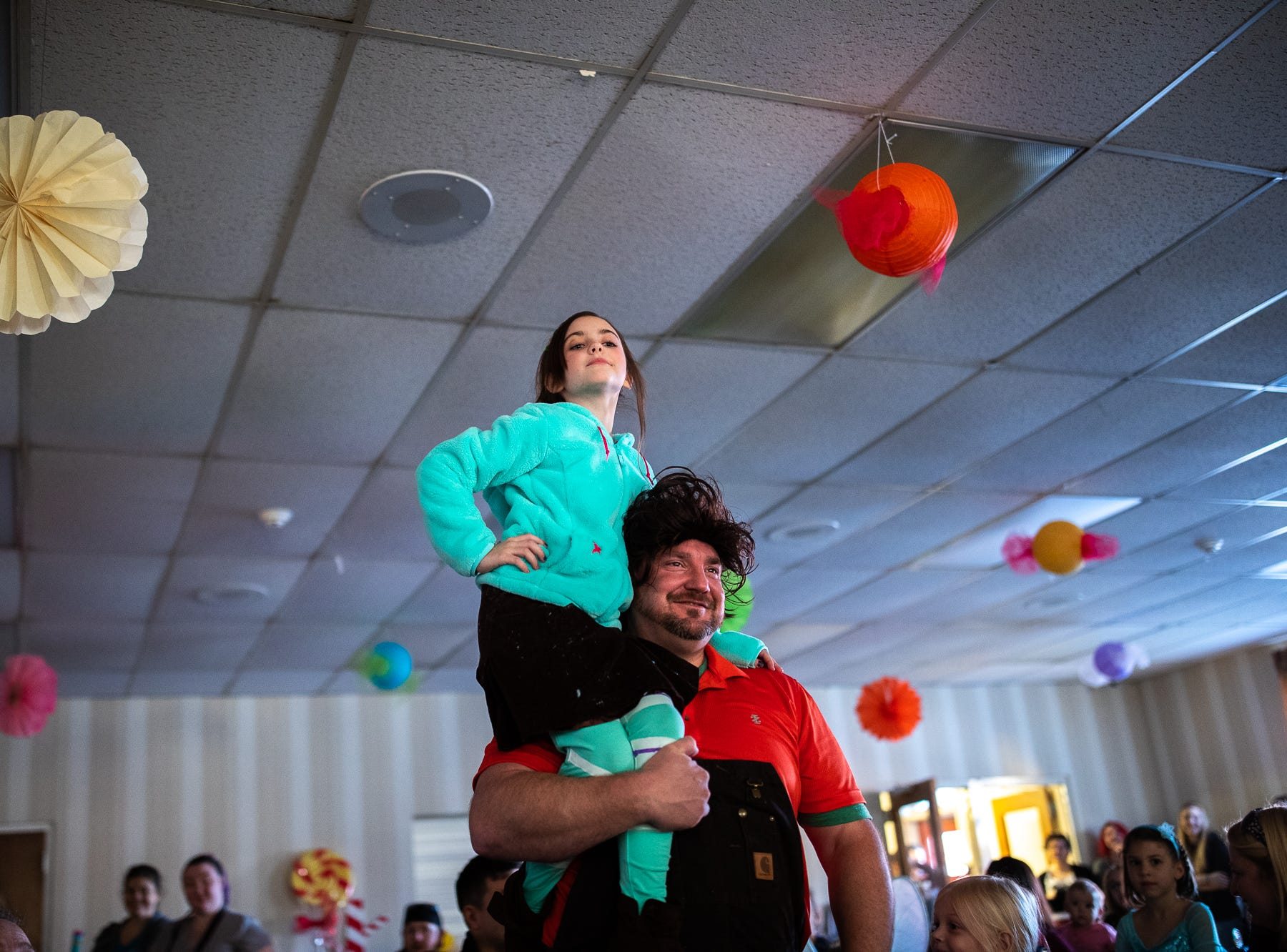 Wreck-It Ralph and Vanellope make their entrance during a princess teatime hosted by the Black Rose Rollers, Saturday, Feb. 9, 2019, at the Hanover YWCA.