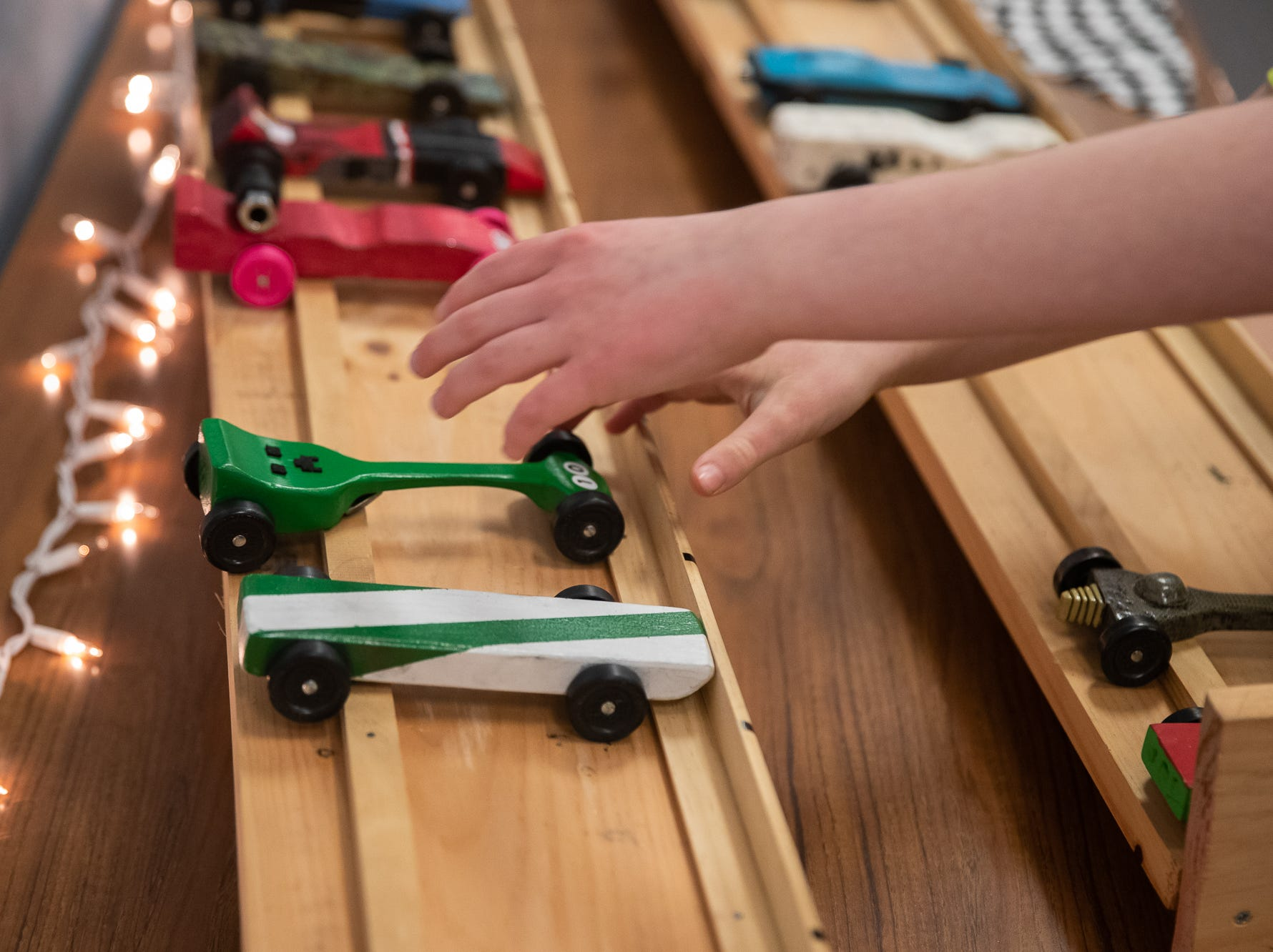 Cub scouts grab their pinewood cars during the cub scouts pack 127 Pinewood Derby event at Lincoln Intermediate Unit 12, Sunday, Feb. 10 in New Oxford. The scouts had a month to design their custom pinewood cars to race in the event.