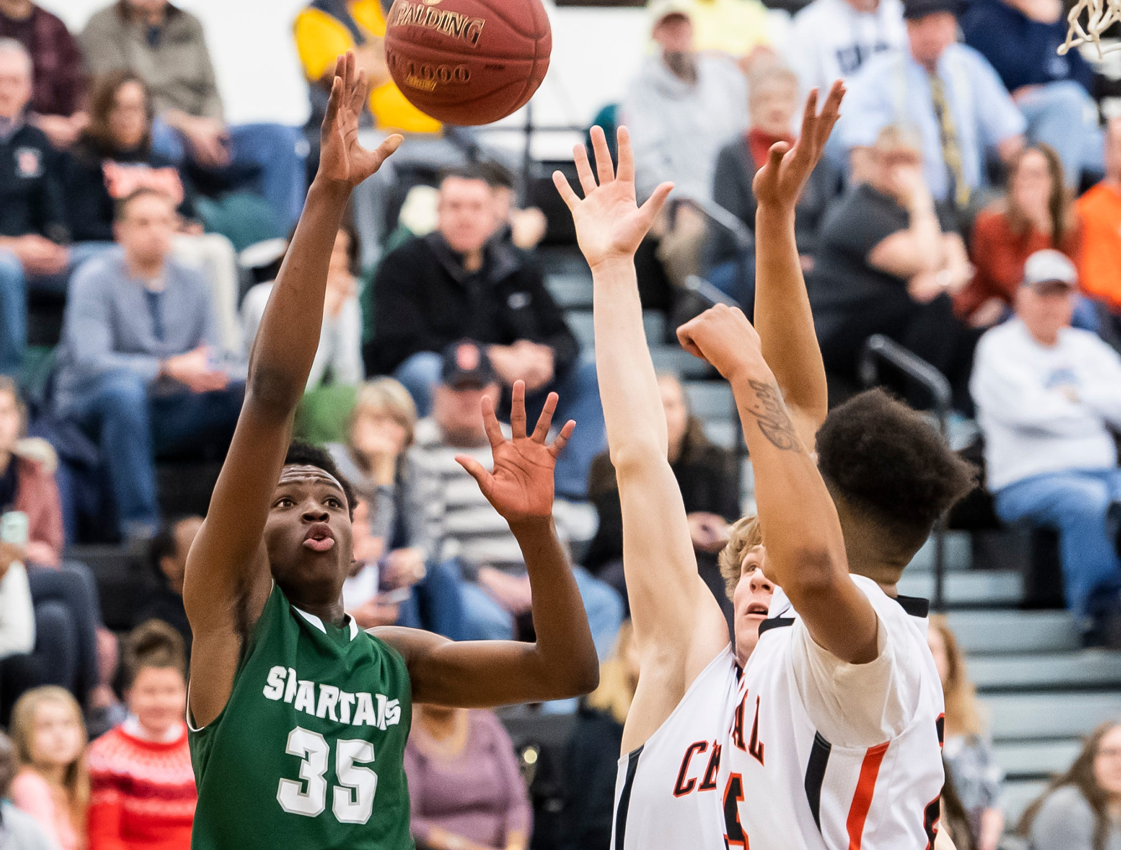 York County Tech's Jahkwan Batty shoots the ball during play against  Central York in a YAIAA quarterfinal game at Red Lion High School Saturday, February 9, 2019. Batty led the Spartans with 14 points.