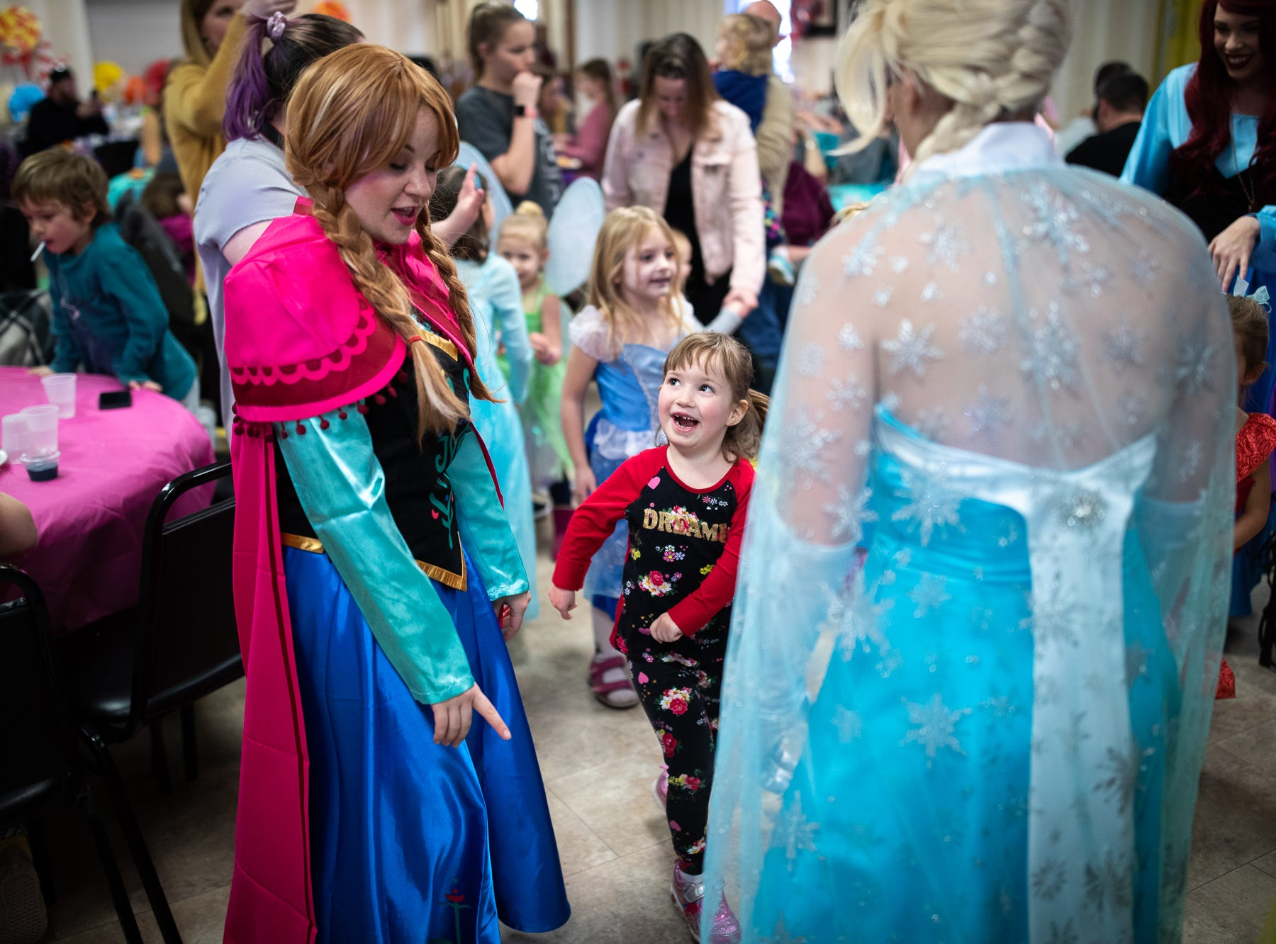 Princesses dance with kids during a princess teatime hosted by the Black Rose Rollers, Saturday, Feb. 9, 2019, at the Hanover YWCA.