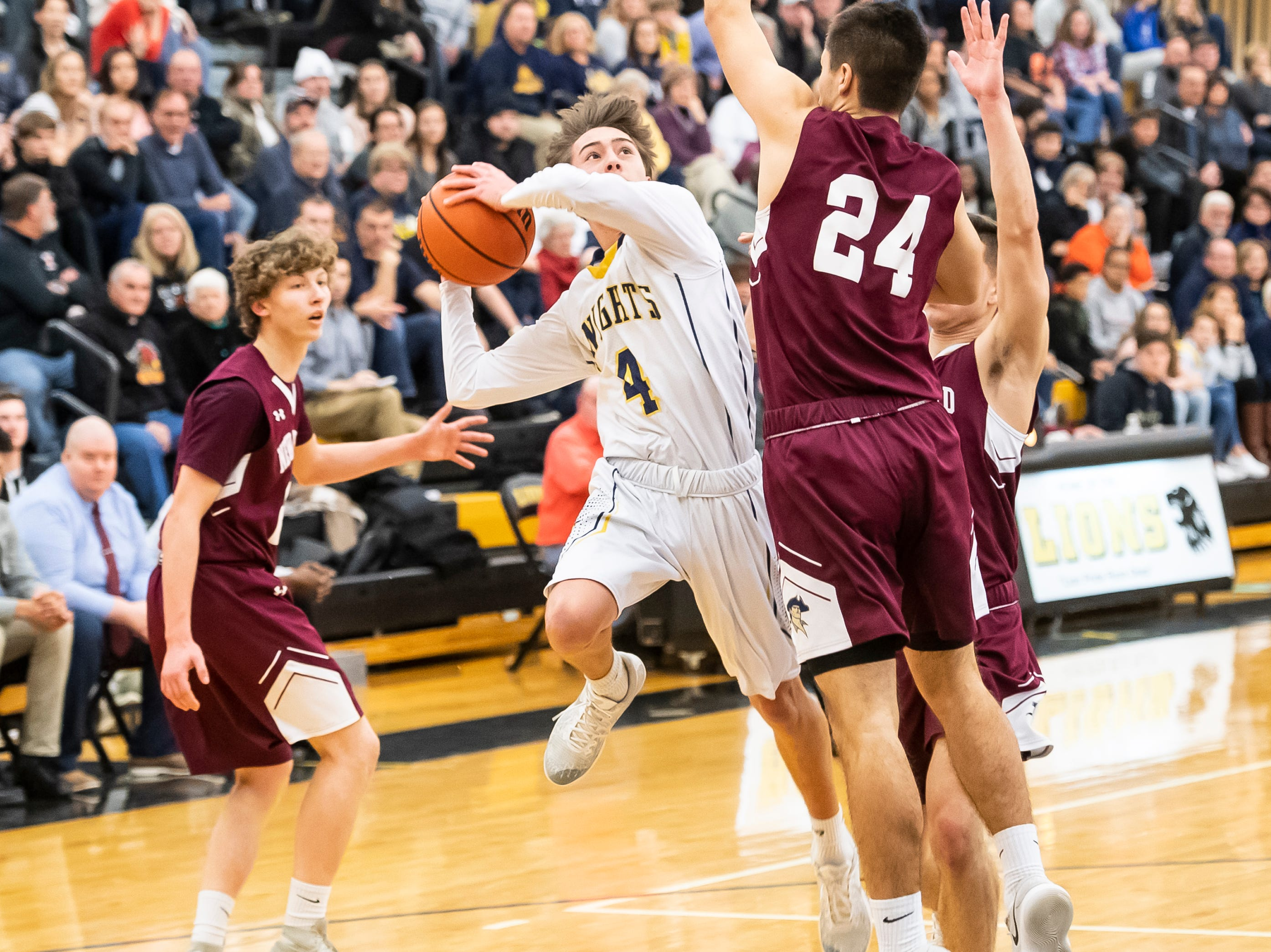 Eastern York's Trevor Seitz draws a foul while shooting a layup during play in a YAIAA quarterfinal game against New Oxford at Red Lion High School Saturday, February 9, 2019.