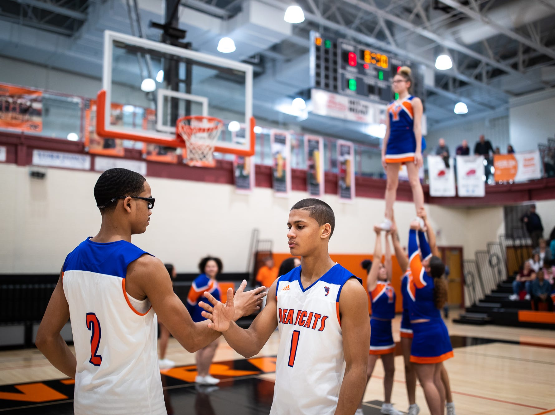 York High's Cameron Gallon (2) is introduced by York High's Tobee Stokes (1) during the first half of a YAIAA quarterfinal between York High and Dover, Saturday, Feb. 9, 2019, at Central York High School. West York led Dover 48-35 at the half.