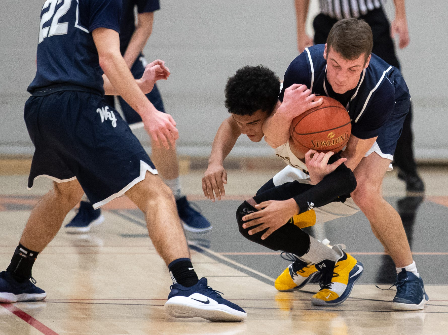 West York's Andrew LaManna (5) wrestles with Littlestown's Jayden Weishaar (32) for the ball during the second half of the YAIAA boys' basketball quarterfinals between Littlestown and West York, Saturday, Feb. 9, 2019, at Central York High School. The Littlestown Bolts defeated the West York Bulldogs 73-63.
