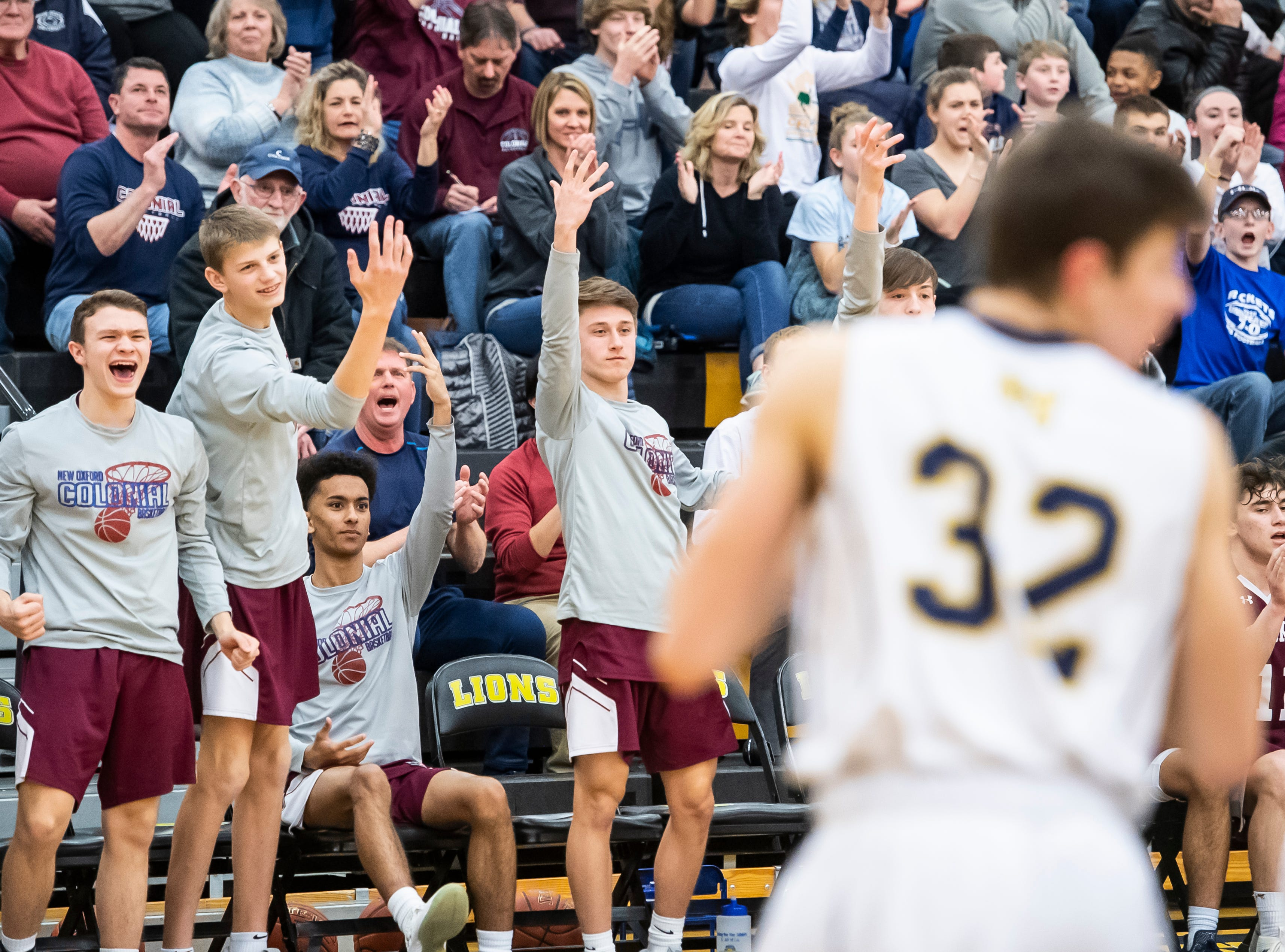 The New Oxford bench celebrates a bucket late in the fourth quarter of play against Eastern York in a YAIAA quarterfinal game at Red Lion High School Saturday, February 9, 2019. The Colonials won 54-44.