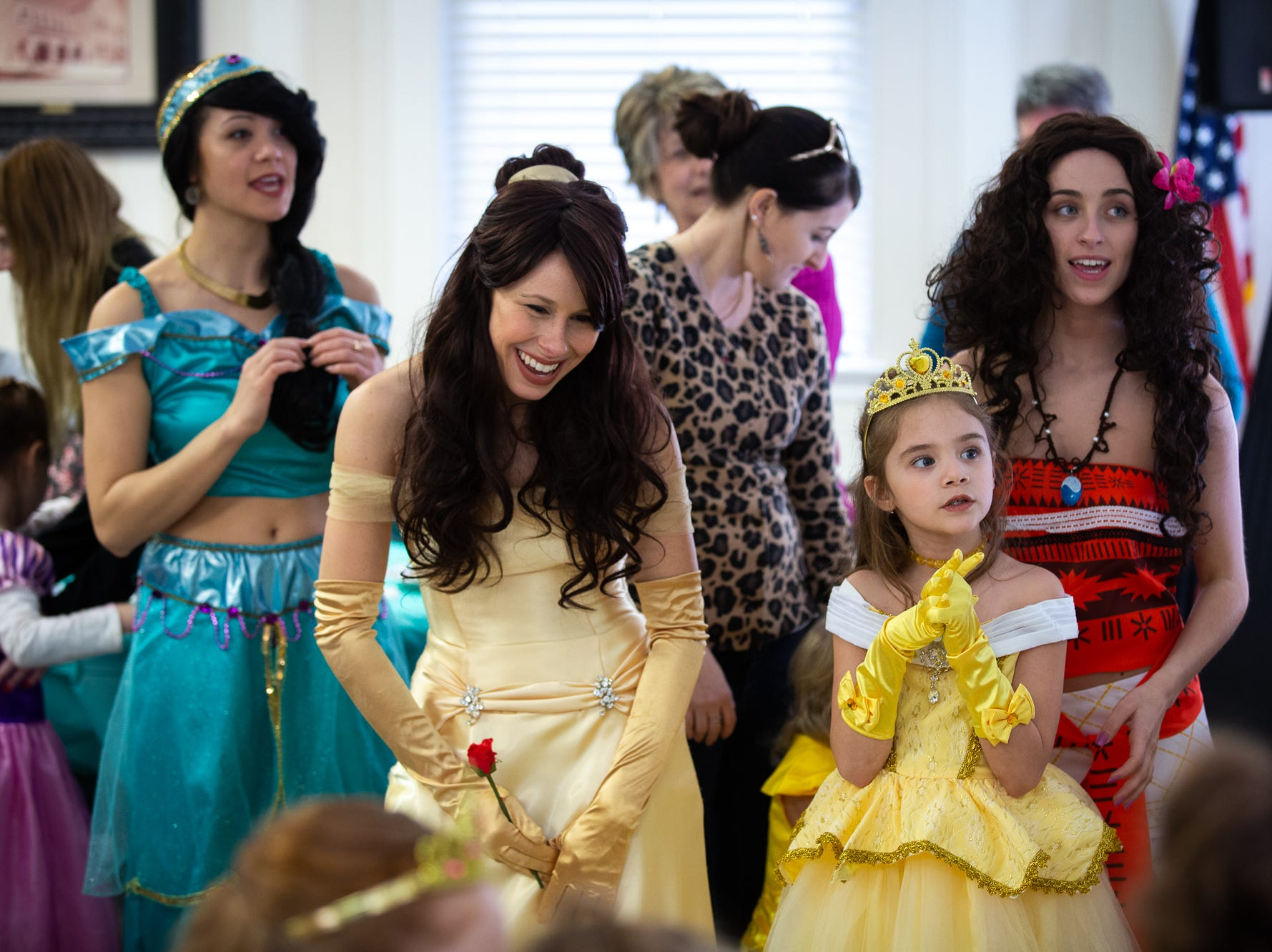 Princess Belle sings along with Skylar, 6, also dressed as princess Belle, during a princess teatime hosted by the Black Rose Rollers, Saturday, Feb. 9, 2019, at the Hanover YWCA.