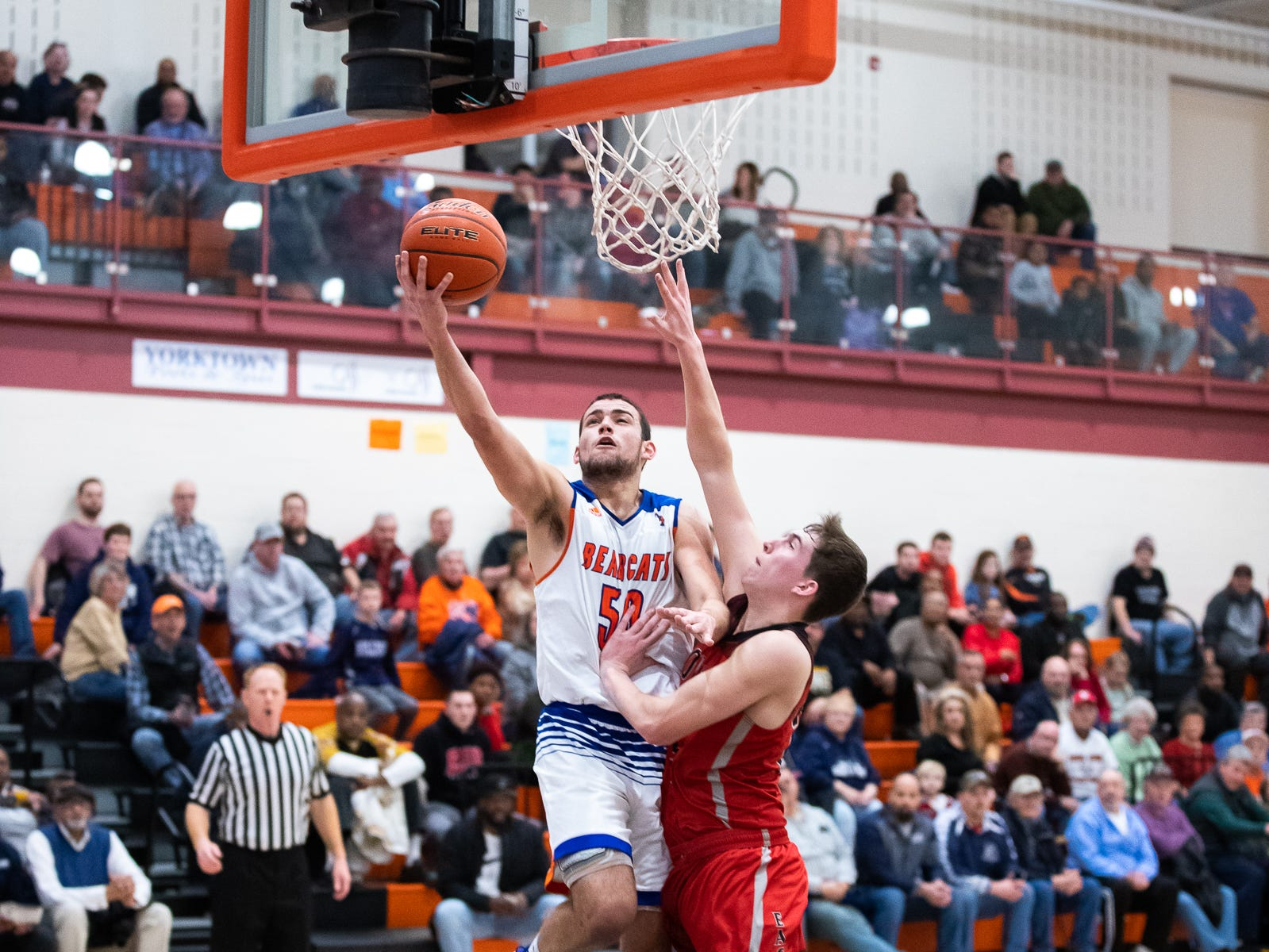 York High's Seth Bernstein (50) shoots a layup during the second half of a YAIAA quarterfinal between York High and Dover, Saturday, Feb. 9, 2019, at Central York High School. The York High Bearcats defeated the Dover Eagles 75-53.