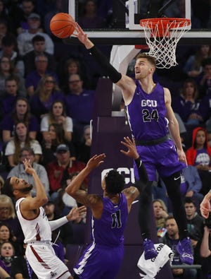 GCU's Tim Finke (24) blocks a shot from New Mexico State's Shunn Buchanan (1) during the first half at Grand Canyon University Arena in Phoenix, Ariz. on February 9, 2019.