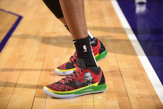 Mikal Bridges rocking Nike sneakers with a Martin Luther King Jr. theme in celebrating Black History Month.