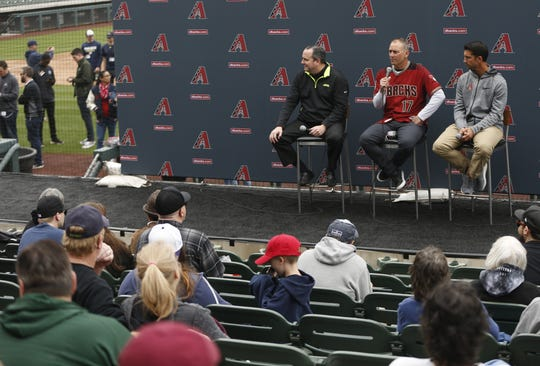 Diamondbacks President Derrick Hall, manager Torey Lovullo and General Manager Mike Hazen answer questions from fans during the Diamondbacks Fan Fest on Saturday.