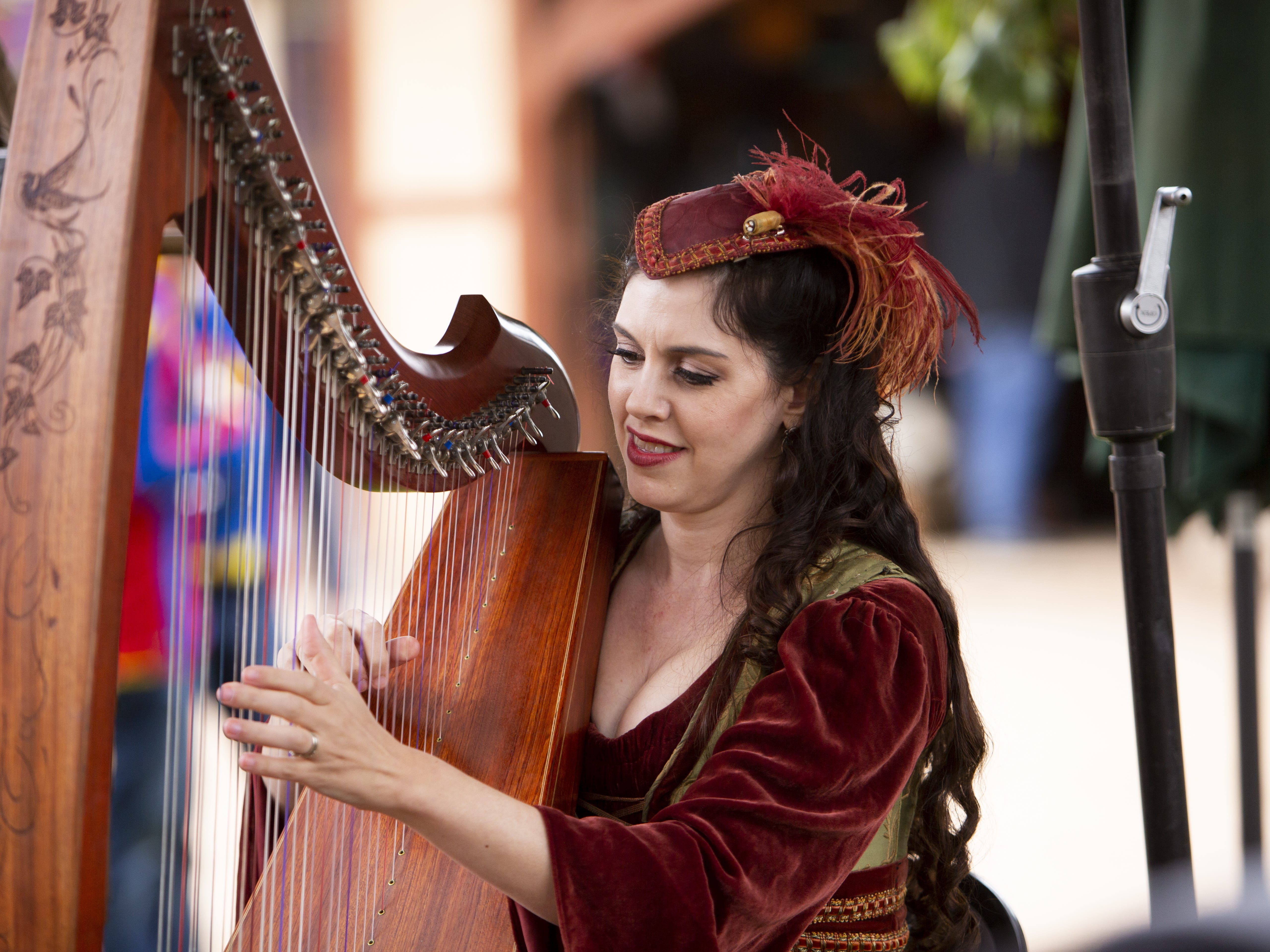 Sarah Marie Mullen plays the harp at the Arizona Renaissance Festival 2019 on Feb. 9, 2019 in Gold Canyon, Ariz.