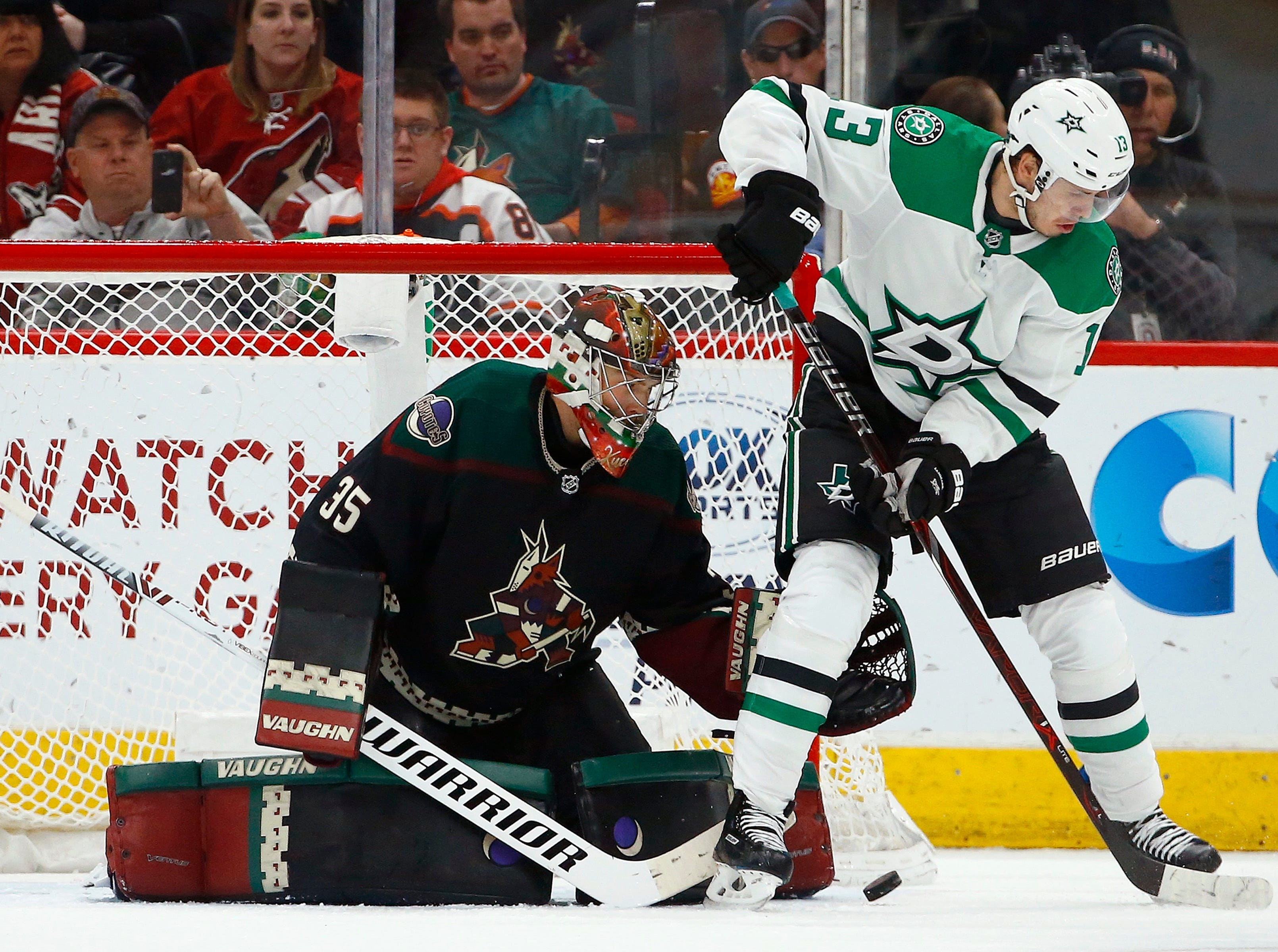 Arizona Coyotes goaltender Darcy Kuemper (35) slides over to make a save on a rebound shot by Dallas Stars center Mattias Janmark (13) during the second period of an NHL hockey game Saturday, Feb. 9, 2019, in Glendale, Ariz. (AP Photo/Ross D. Franklin)