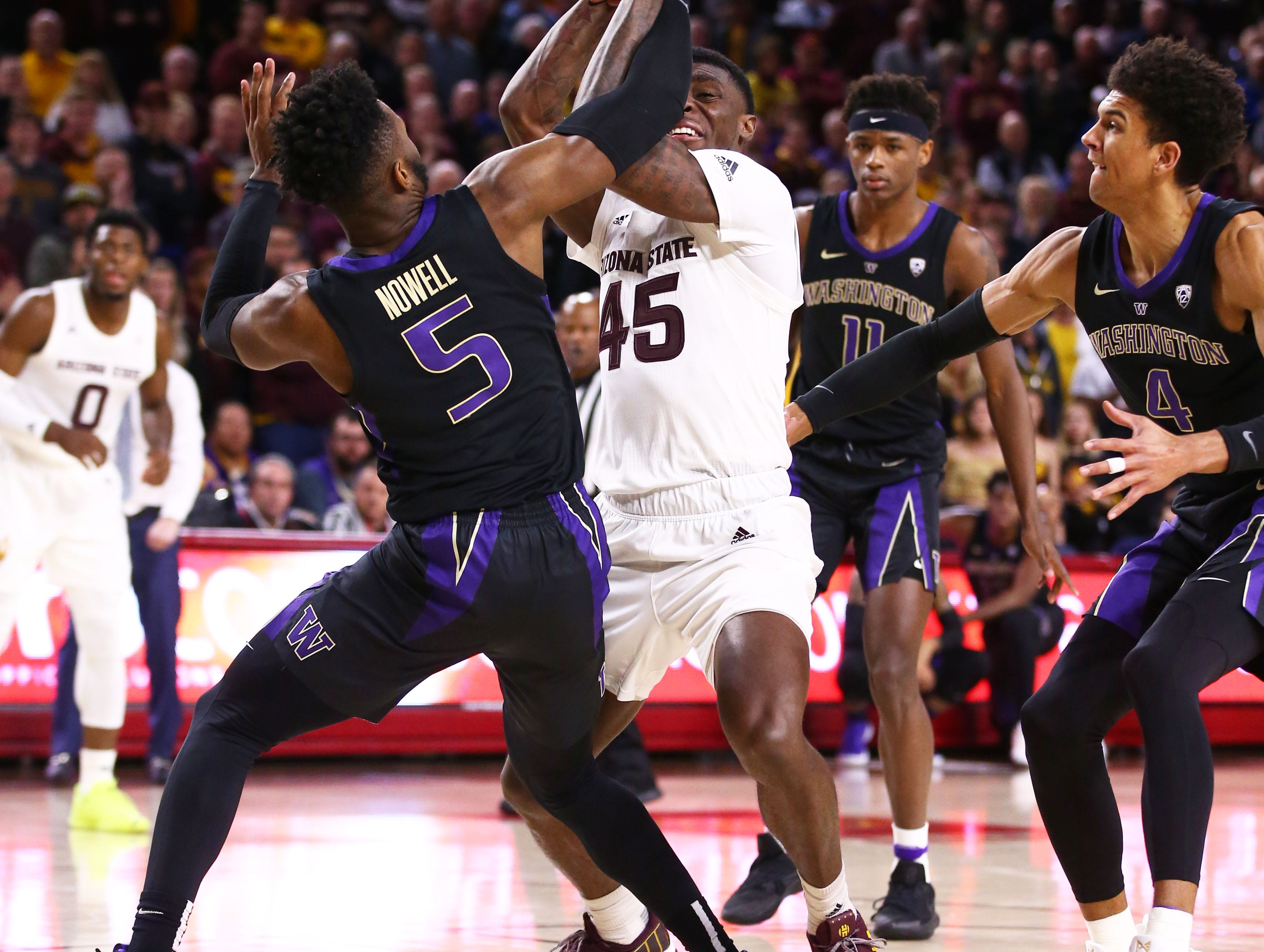 Arizona State Sun Devils forward Zylan Cheatham is fouled by Washington Huskies guard Jaylen Nowell in the second half on Feb. 9 at Wells Fargo Arena in Tempe.