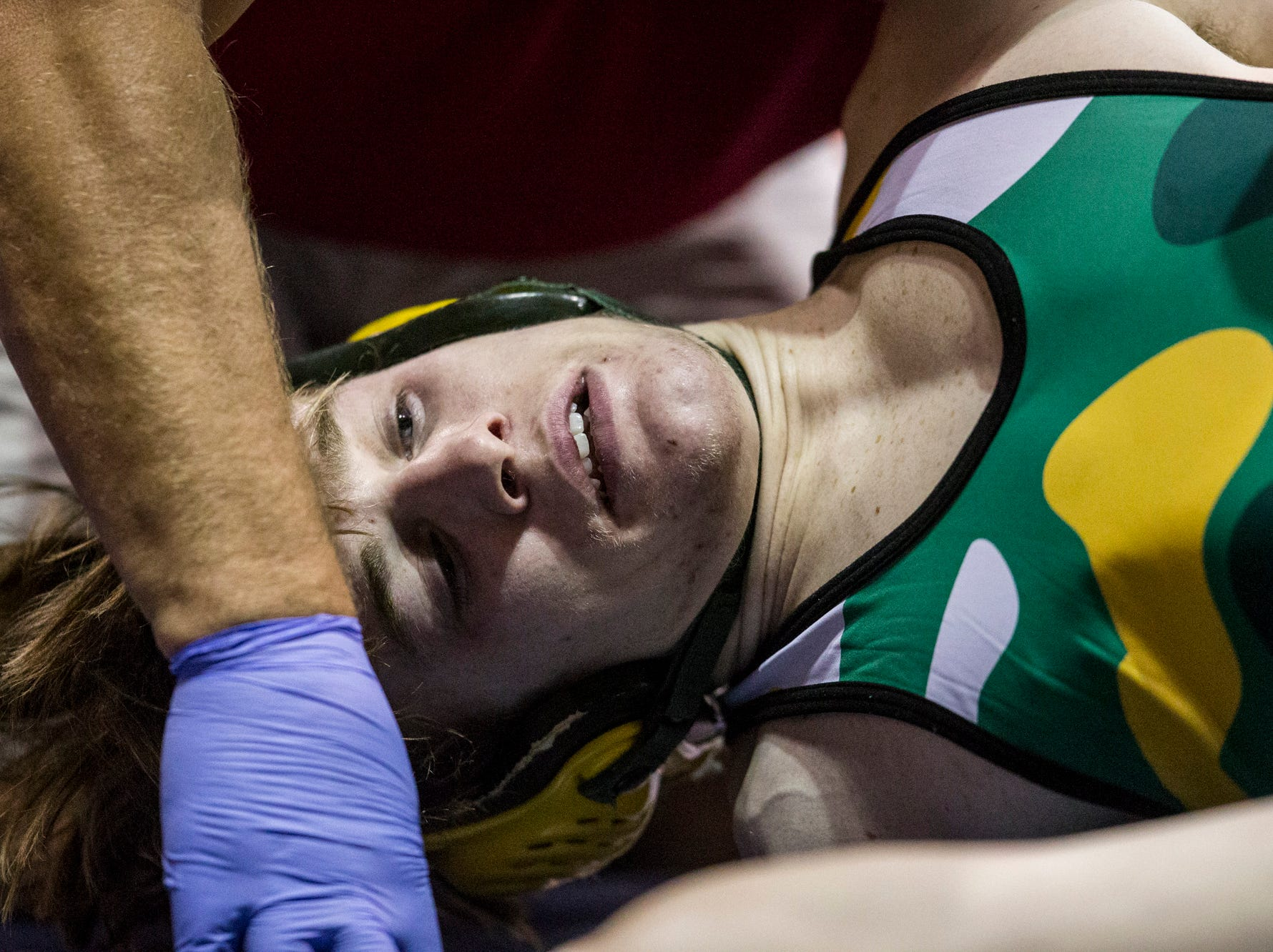 Horizon's Alex Maxson lies in pain on the mat during his match against Ironwood's George Galaz during the boys wrestling championship on Saturday, Feb. 9, 2019, at Prescott Valley Event Center in Prescott Valley, Ariz.