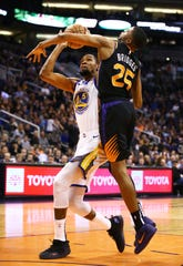 Phoenix Suns forward Mikal Bridges pressures the shot by Golden State Warriors forward Kevin Durant in the second half on Feb. 8 at Talking Stick Resort Arena.