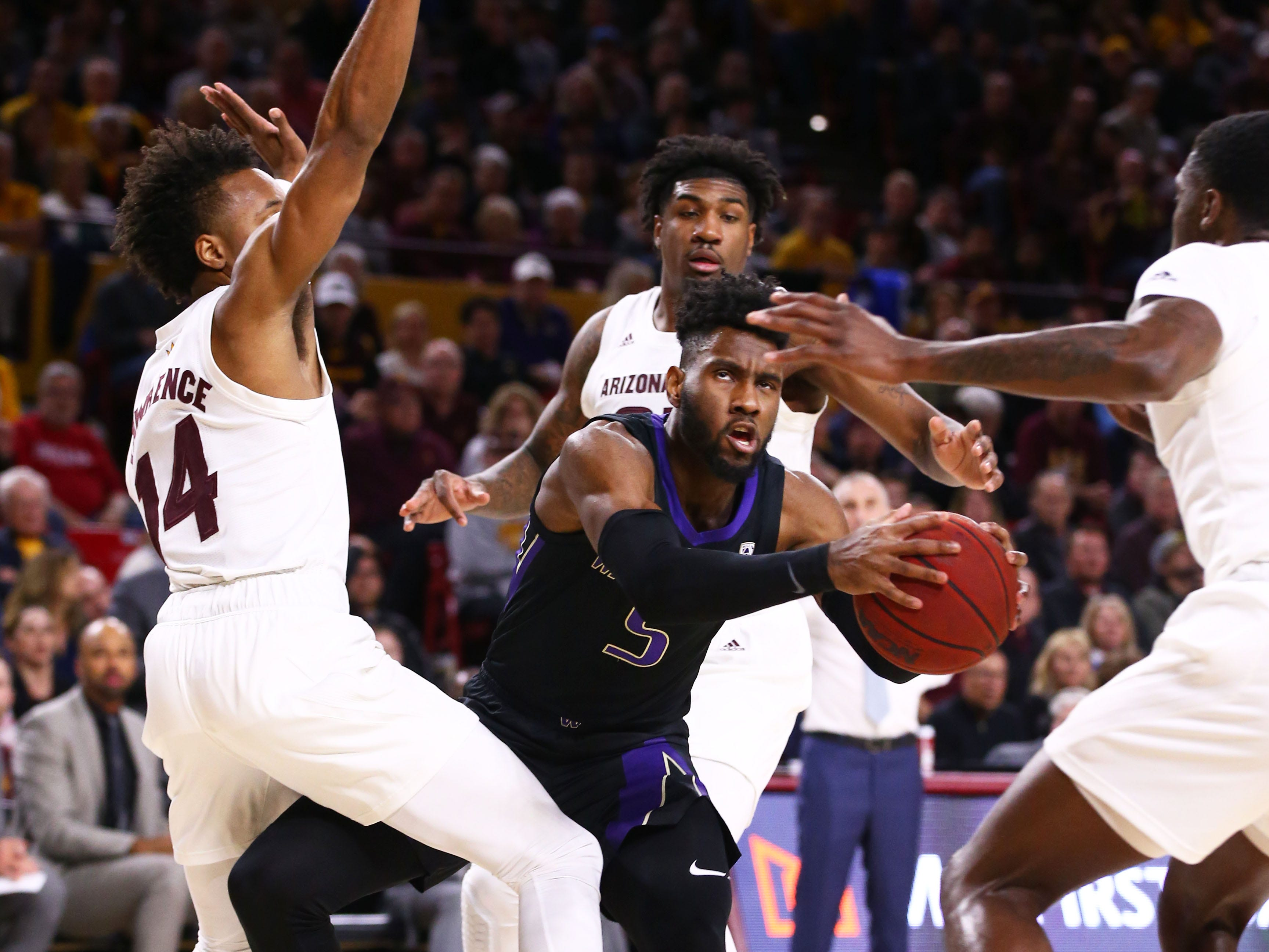 Arizona State Sun Devils forward Kimani Lawrence guards Washington Huskies' Jaylen Nowell in the first half on Feb. 9 at Wells Fargo Arena in Tempe.