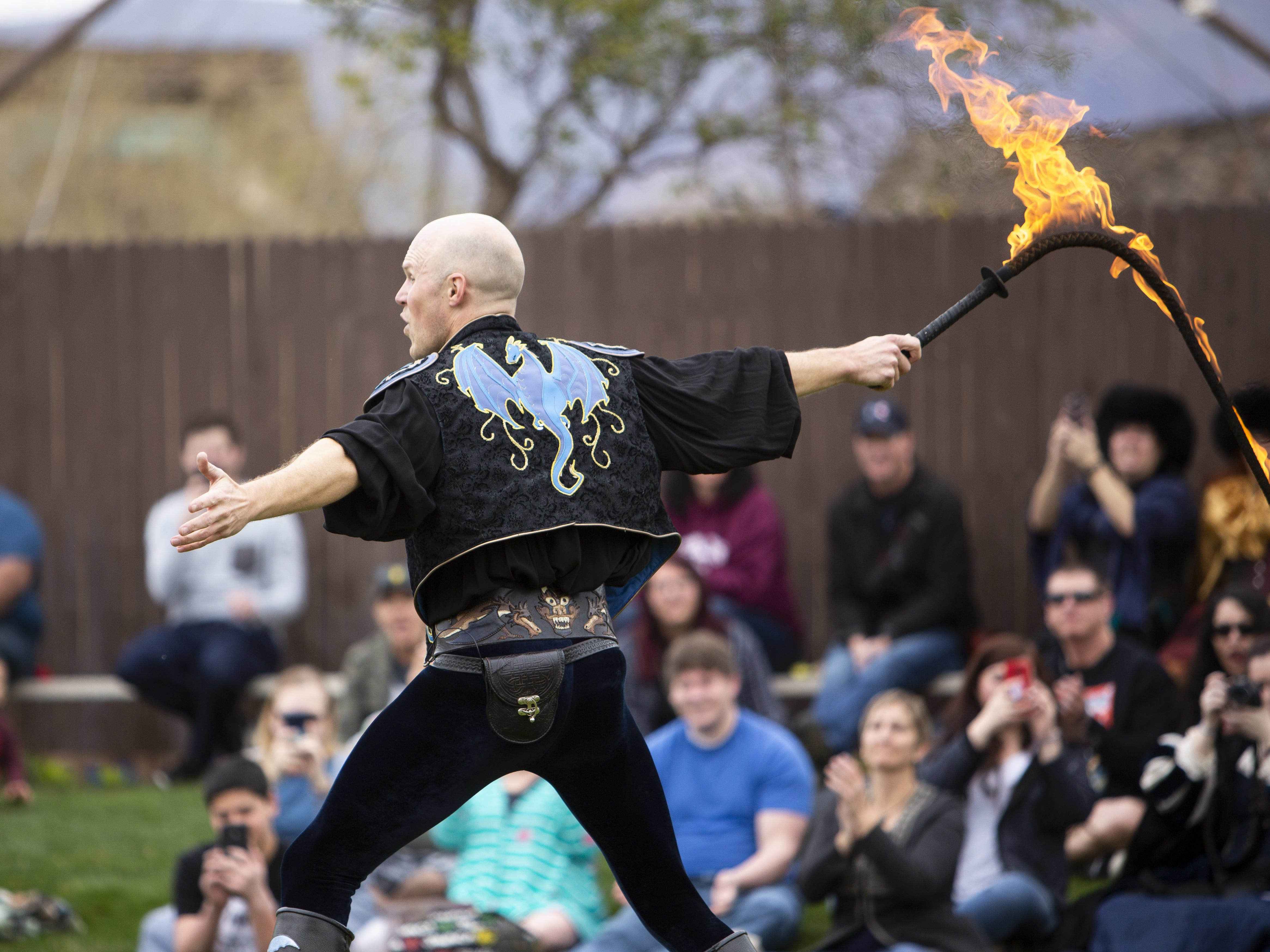 "Adam ""Crack"" Winrich performs his show with a whip on fire at the Arizona Renaissance Festival 2019 on Feb. 9, 2019 in Gold Canyon, Ariz."