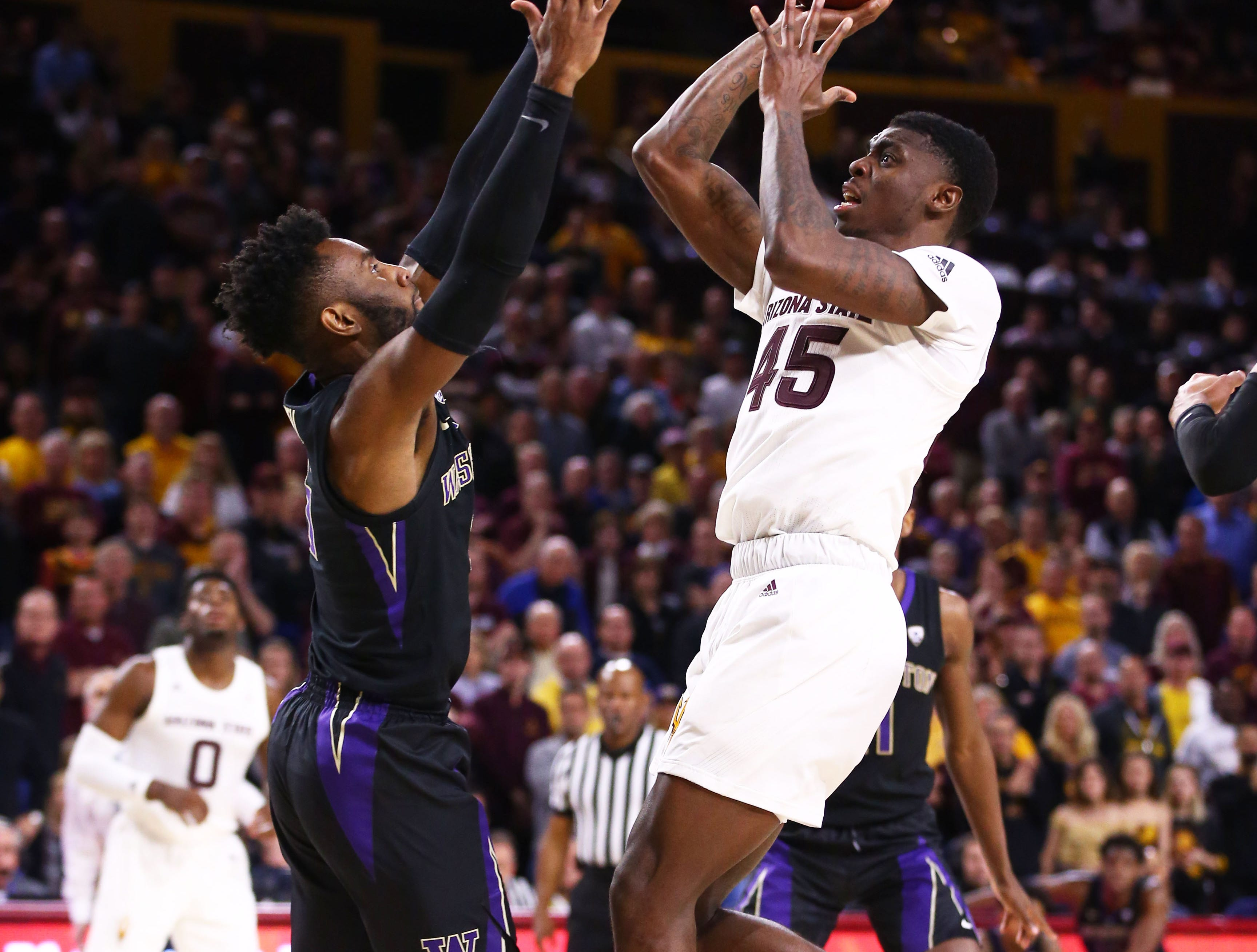 Arizona State Sun Devils forward Zylan Cheatham shoots over Washington Huskies guard Jaylen Nowell in the second half on Feb. 9 at Wells Fargo Arena in Tempe.
