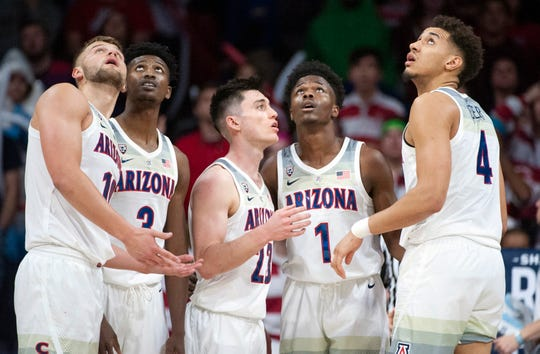 Feb 9, 2019: Arizona Wildcats forward Ryan Luther (10) guard Dylan Smith (3) guard Alex Barcello (23) guard Devonaire Doutrive (1) and center Chase Jeter (4) (left to right) watch a replay during the second half against the Washington State Cougars at McKale Center.