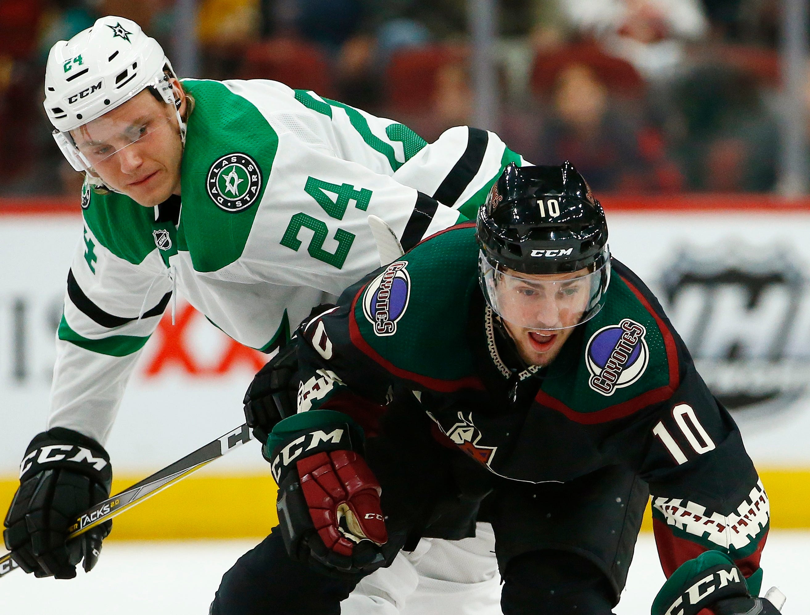 Arizona Coyotes center Jordan Weal (10) passes the puck in front of Dallas Stars left wing Roope Hintz (24) during the third period of an NHL hockey game Saturday, Feb. 9, 2019, in Glendale, Ariz. (AP Photo/Ross D. Franklin)