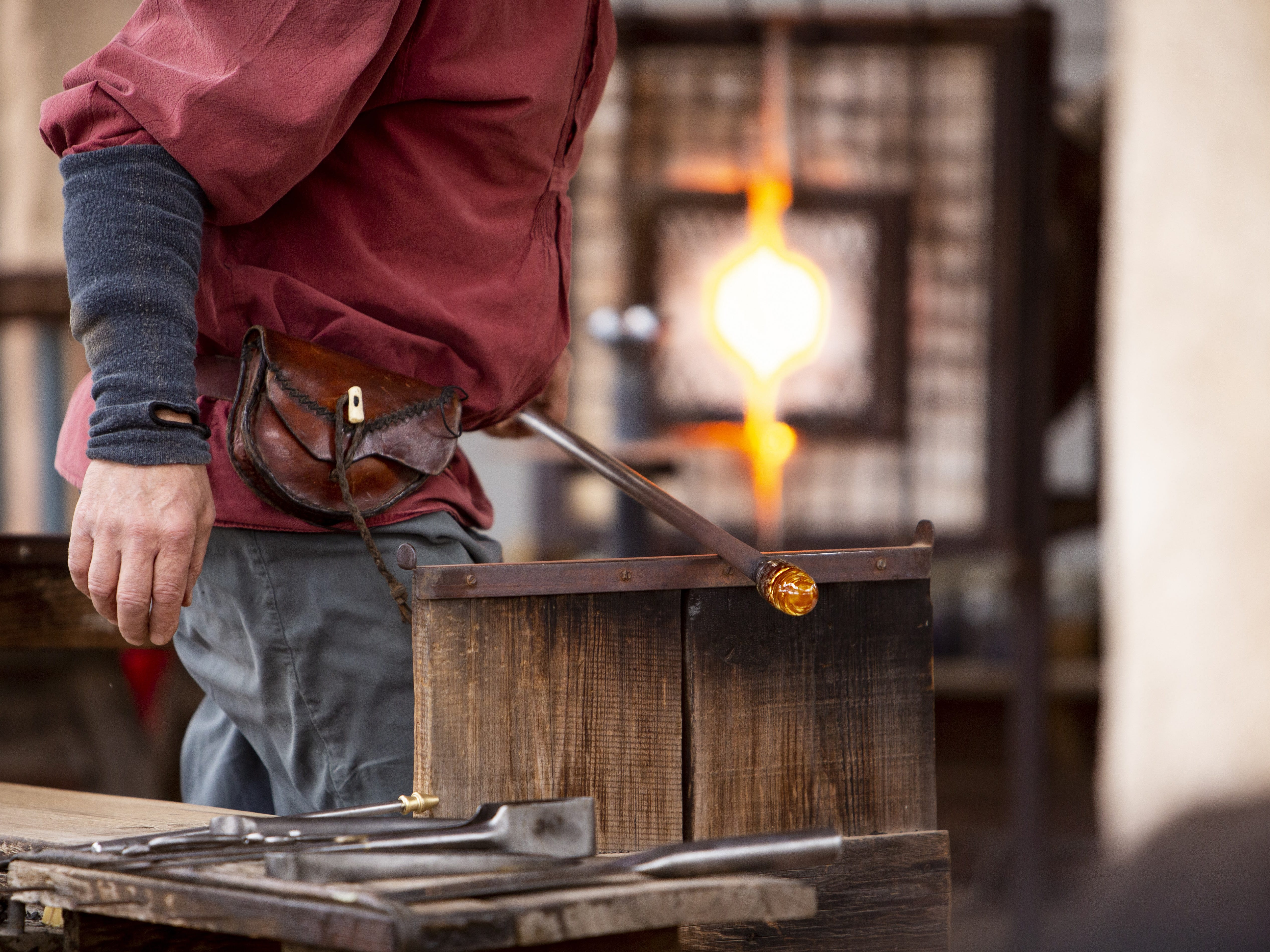 Peter Andres demonstrates how to begin a vase made of glass at the Arizona Renaissance Festival 2019 on Feb. 9, 2019 in Gold Canyon, Ariz.