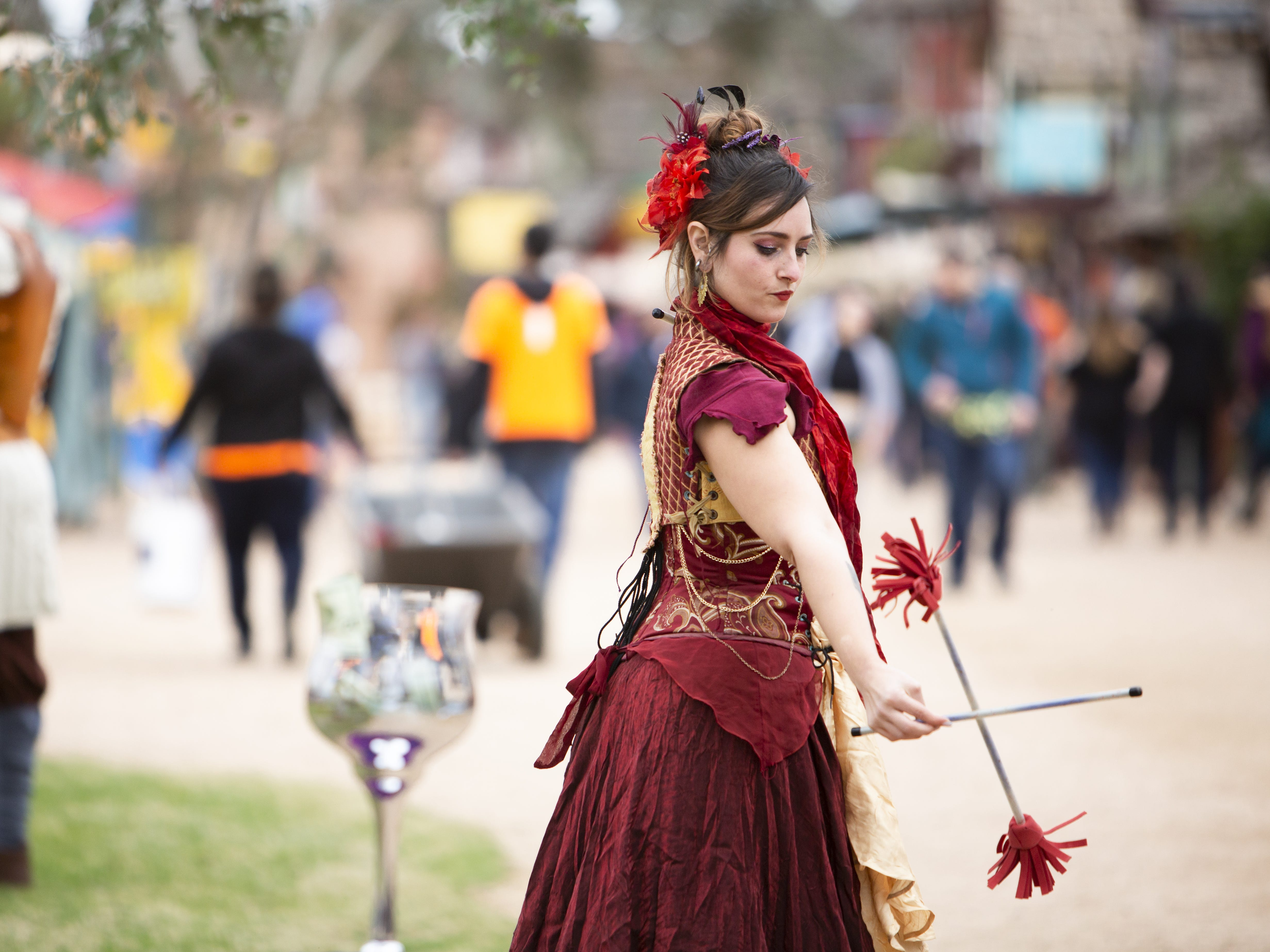 Krista Denewell performs with juggling sticks at the Arizona Renaissance Festival 2019 on Feb. 9, 2019 in Gold Canyon, Ariz.