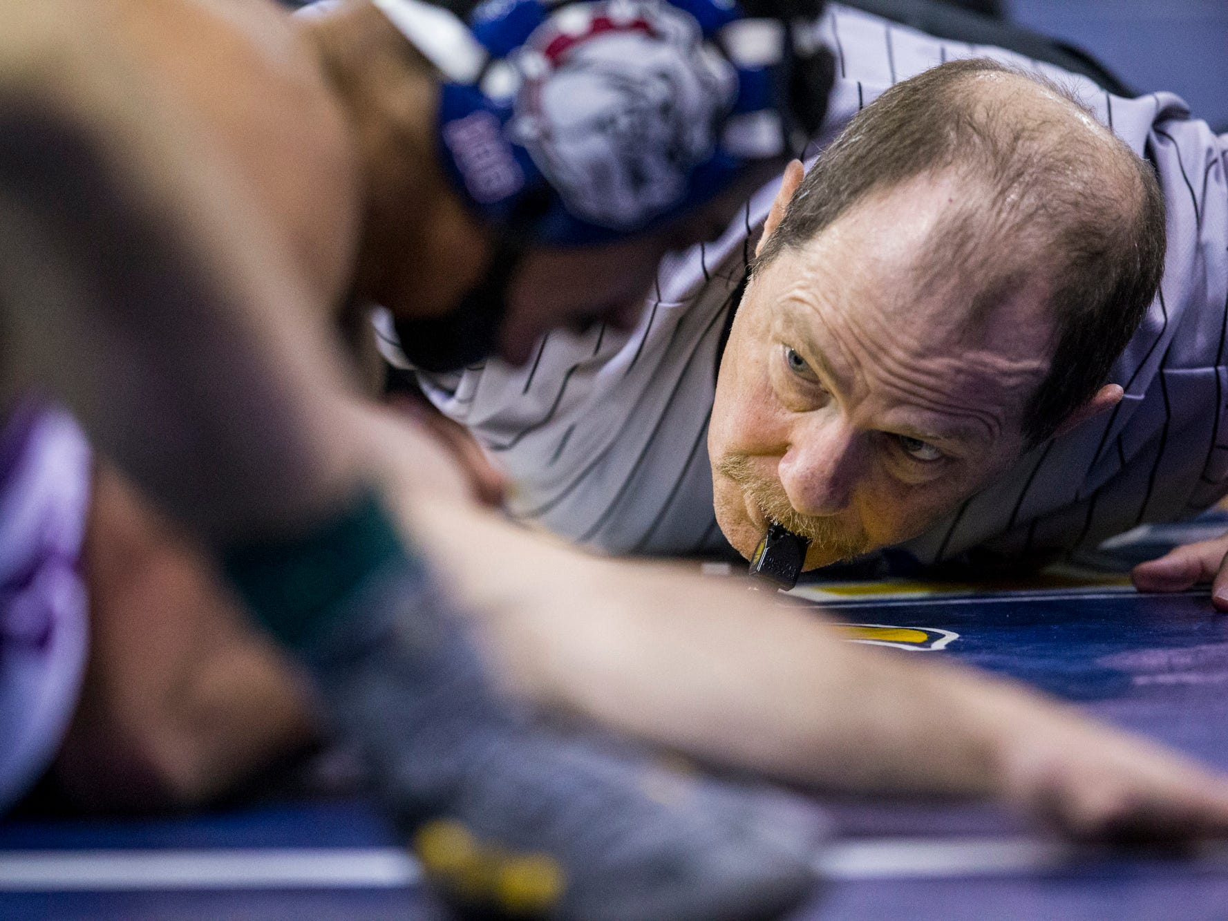 A referee watches the match between Millennium's Eathon Rider and Sierra Linda's Luis Pastoriza during the boys wrestling championship on Saturday, Feb. 9, 2019, at Prescott Valley Event Center in Prescott Valley, Ariz.