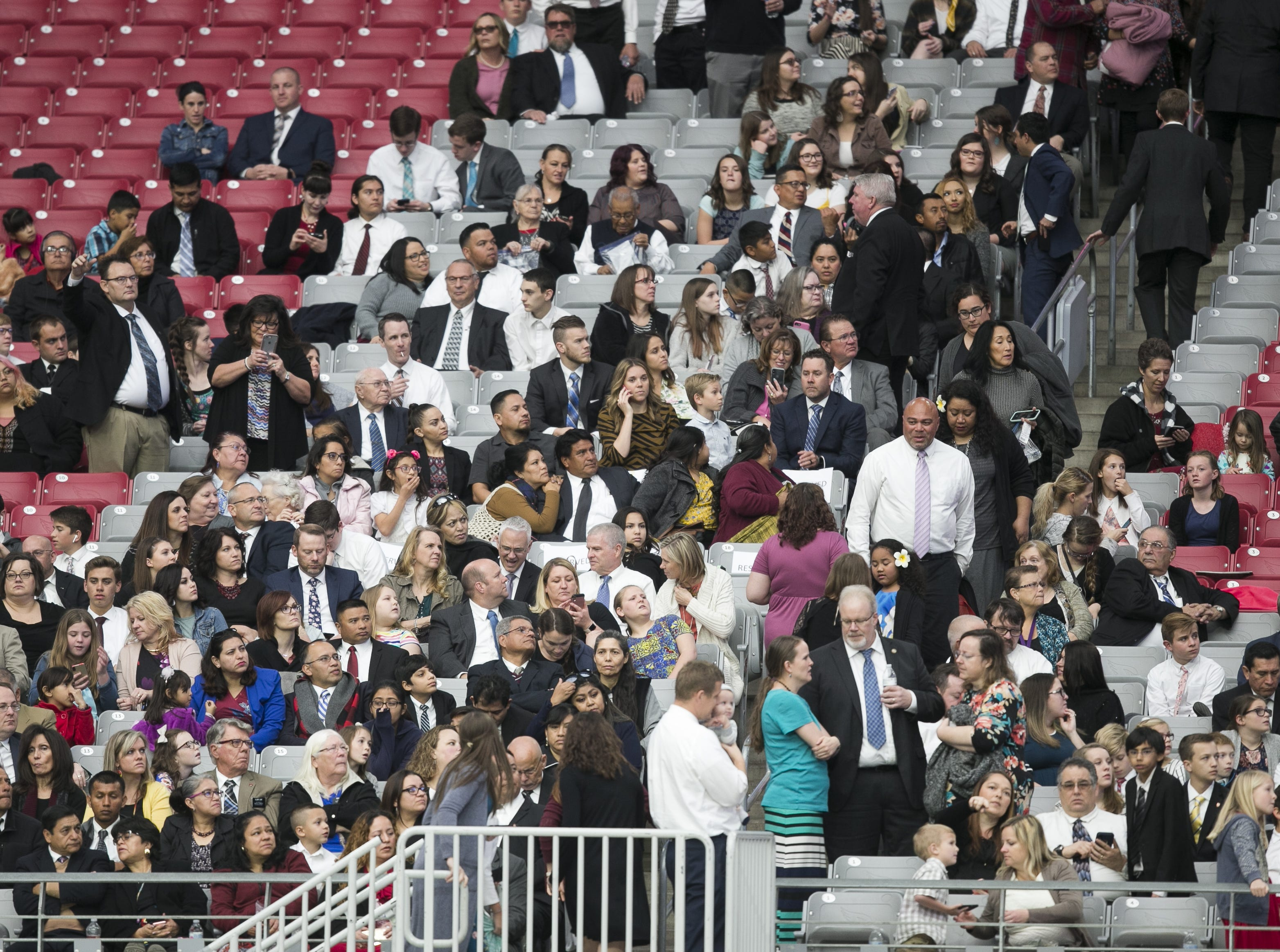 Members of the Church of Jesus Christ of Latter-day Saints wait at State Farm Stadium to hear church President Russell Nelson speak at a devotional in Glendale, Arizona on Sunday, Feb. 10, 2019.