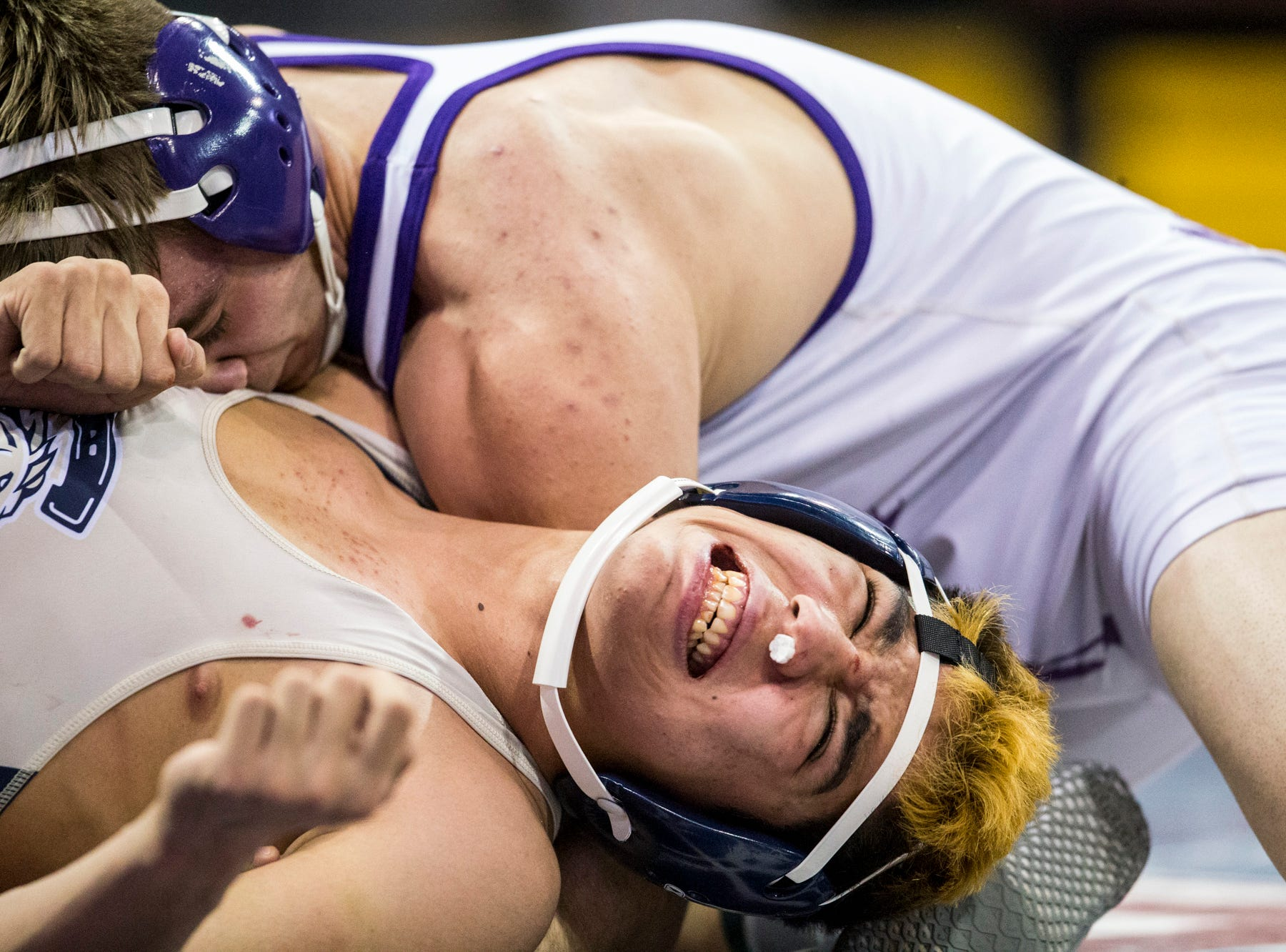 Casteel's Andrew Valle (bottom) wrestles Sunrise Mountain's Dillon Greene during the boys wrestling championship on Saturday, Feb. 9, 2019, at Prescott Valley Event Center in Prescott Valley, Ariz.