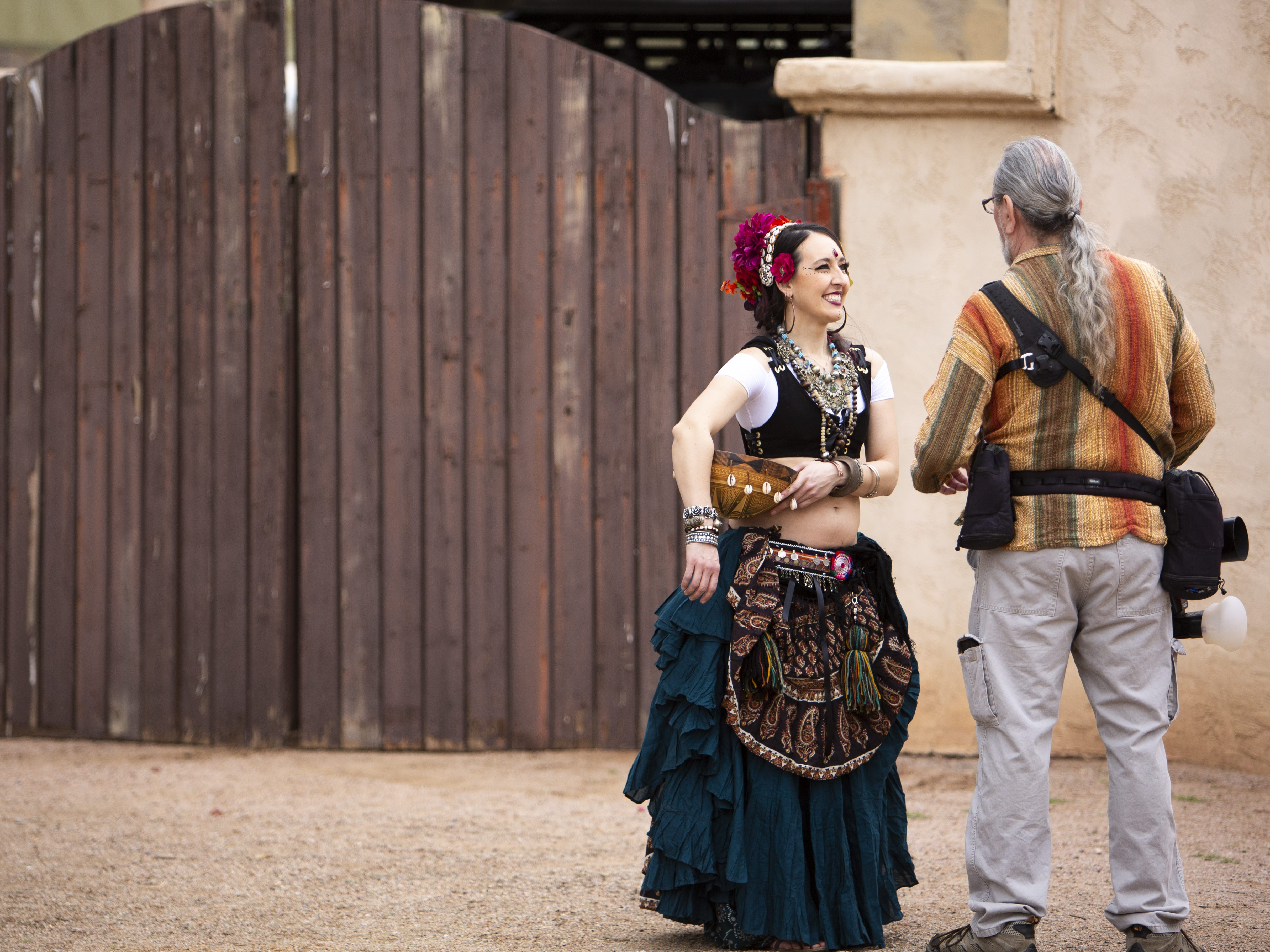 Ghazaal Beledi dancer Nicole Lopez talks to a man taking photos at the Arizona Renaissance Festival 2019 on Feb. 9, 2019 in Gold Canyon, Ariz.