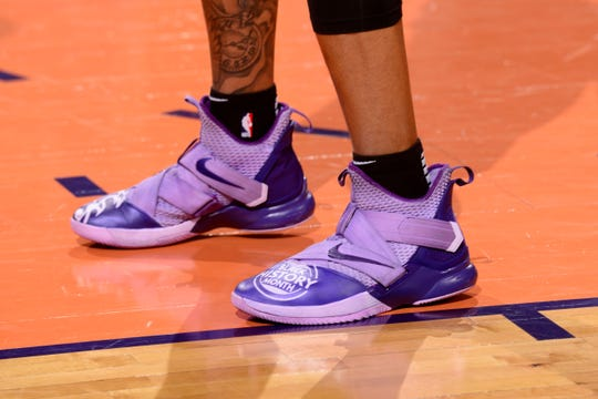 Richaun Holmes wearing purple-on-purple Nike sneakers tied to Black History Month.