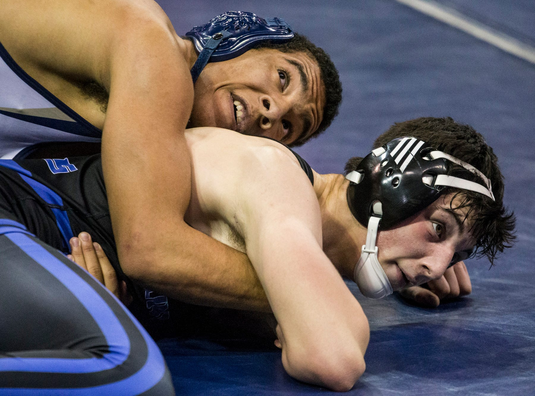 Apollo's Jesse Kovacs (top) wrestles Sunnyside's Fernando Villaescusa during the boys wrestling championship on Saturday, Feb. 9, 2019, at Prescott Valley Event Center in Prescott Valley, Ariz.