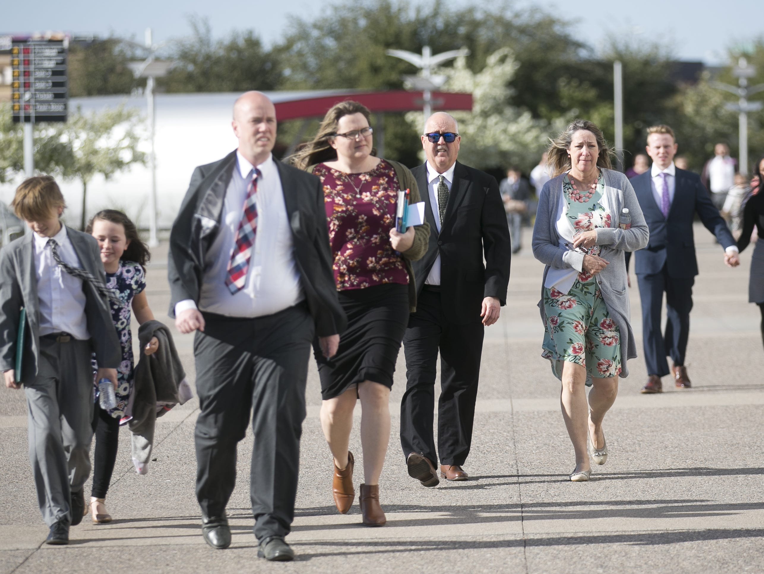 Members of the Church of Jesus Christ of Latter-day Saints arrive at State Farm Stadium to hear church President Russell Nelson speak for a devotional in Glendale, Arizona on Sunday, Feb. 10, 2019.
