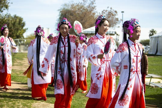 Women from Hope Chinese School walk to the stage before performing Ode to the Pear Flower at the Chinese Week Culture and Cuisine Festival on Feb. 10, 2019, in Margaret T. Hance Park.