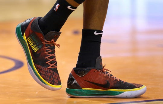 """Phoenix Suns forward Mikal Bridges wears special Martin Luther King Jr. """"I Have A Dream"""" sneakers as part of Black History Month during the second half of an NBA basketball game against the Atlanta Hawks Saturday, Feb. 2, 2019, in Phoenix. The Hawks defeated the Suns 118-112. (AP Photo/Ross D. Franklin)"""