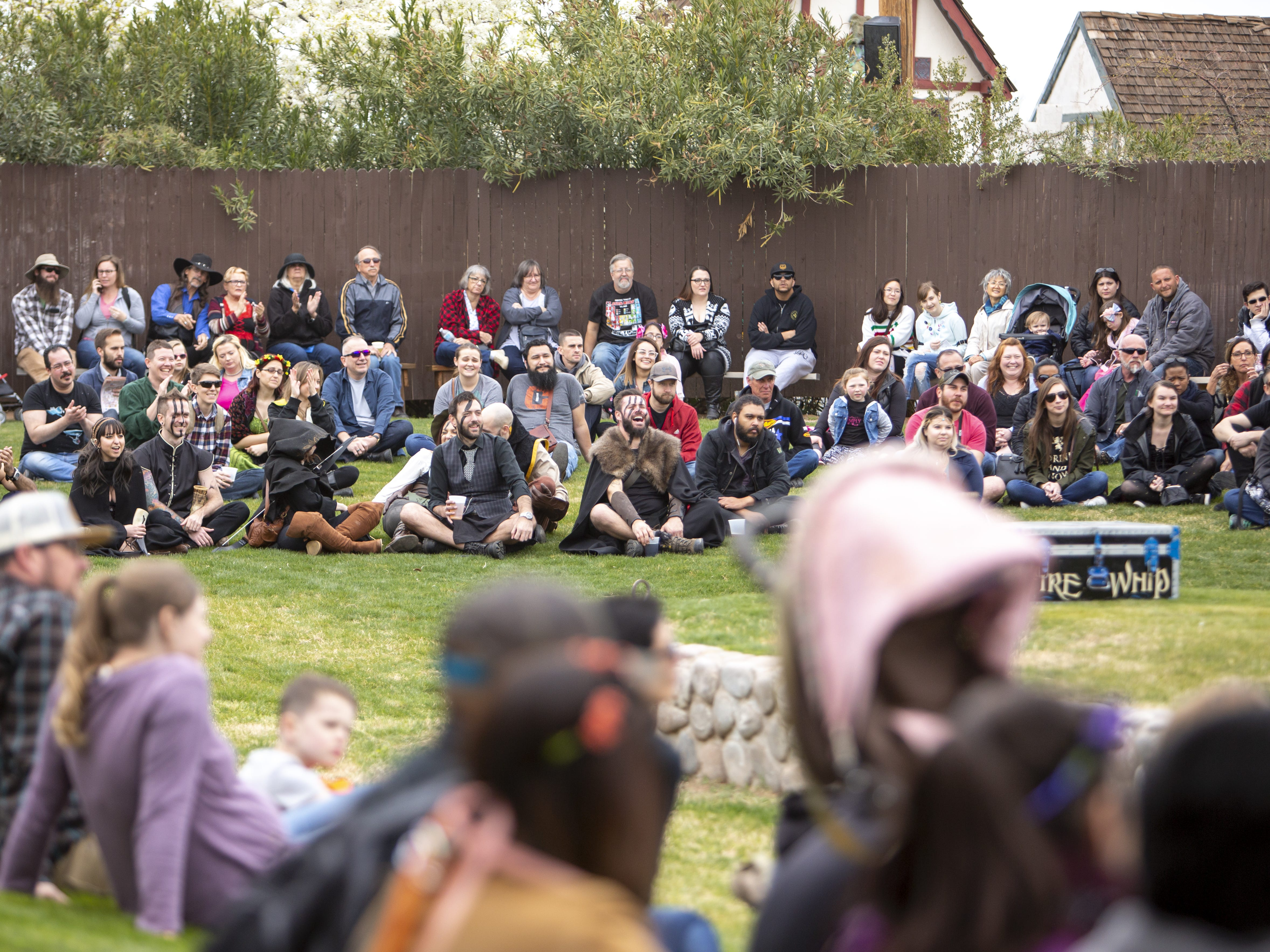 "The crowd watches Adam ""Crack"" Winrich's whip show at the Arizona Renaissance Festival 2019 on Feb. 9, 2019 in Gold Canyon, Ariz."
