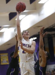 Mesa's Zach Hobbs (24) shoots against Valley Vista's Josiah Jackson (0) during the first half of the boys basketball tournament play-in game at Mesa High School in Mesa, Ariz. on February 8, 2019.