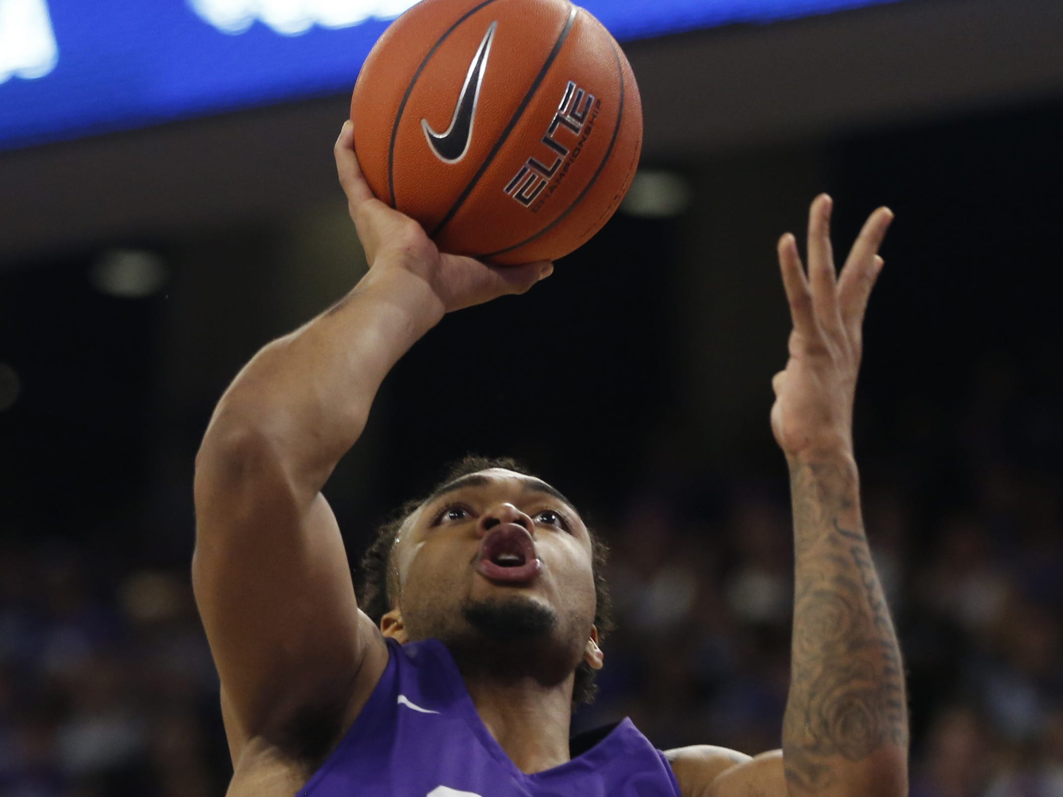 GCU's Carlos Johnson (23) shoots against New Mexico State's Clayton Henry (5) during the first half at Grand Canyon University Arena in Phoenix, Ariz. on February 9, 2019.