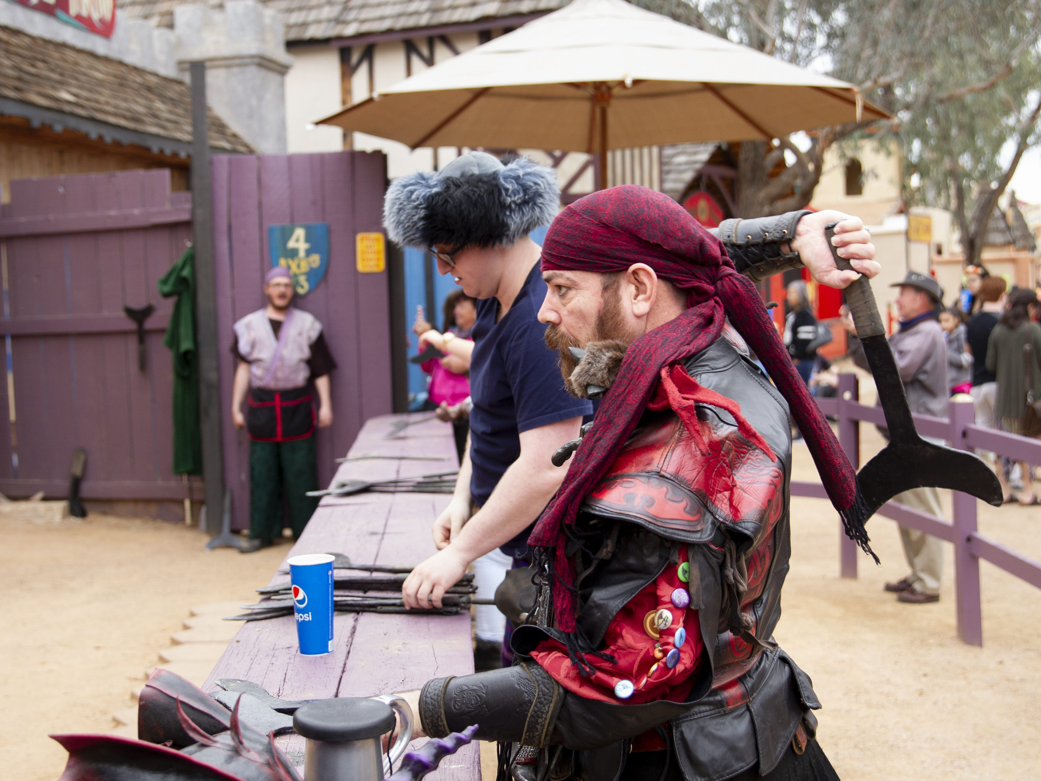Marius Matt throws axes in a competition at the Arizona Renaissance Festival 2019 on Feb. 9, 2019 in Gold Canyon, Ariz.