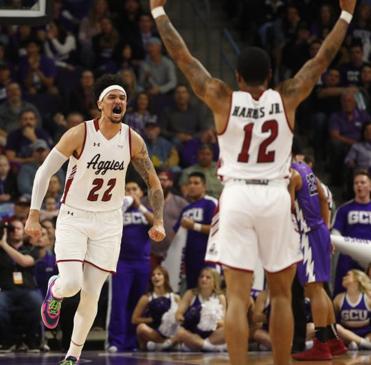 New Mexico State's Eli Chuha (22) reacts with AJ Harris (12) after scoring against GCU during the first half at Grand Canyon University Arena in Phoenix, Ariz. on February 9, 2019.
