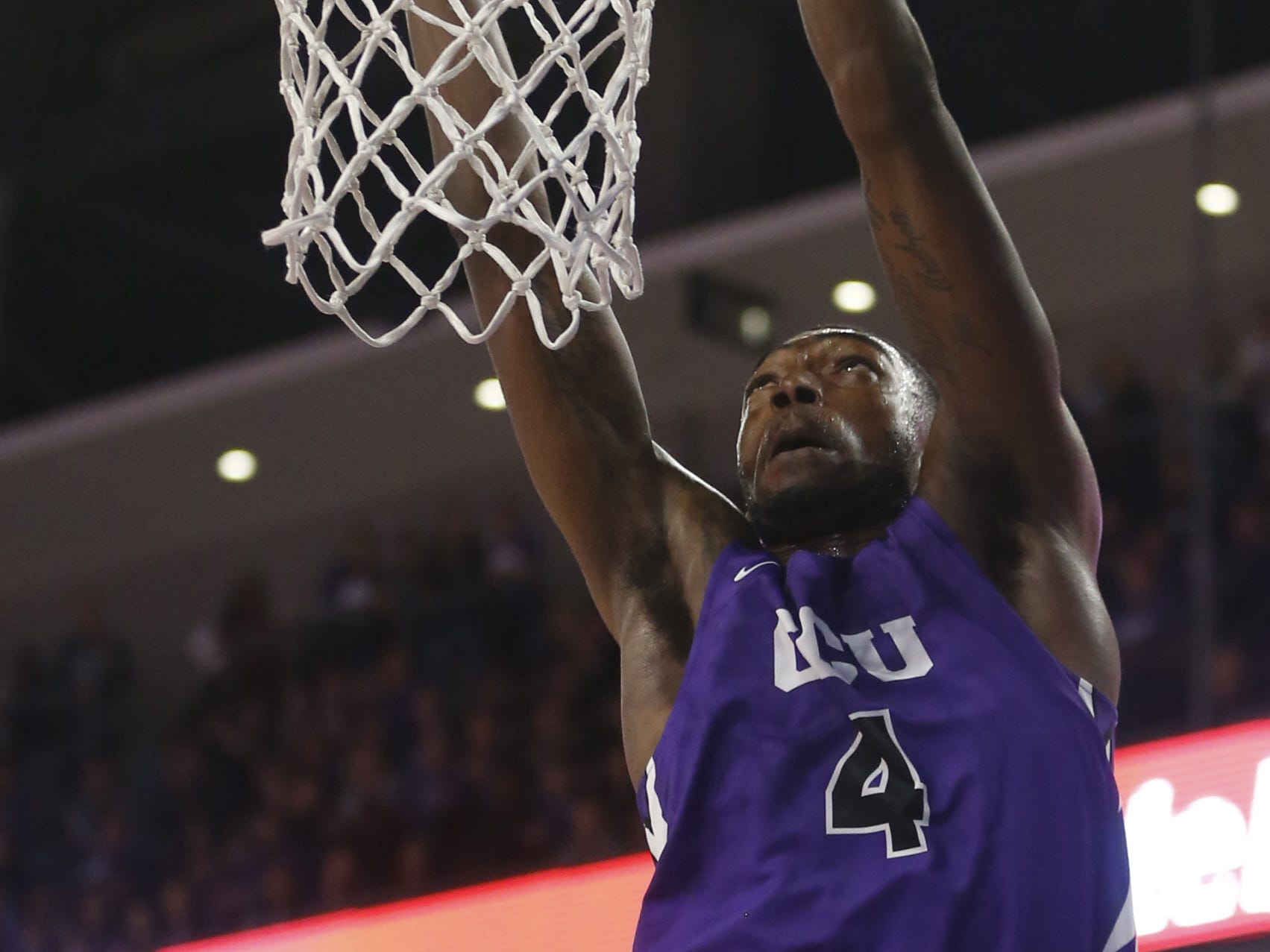 GCU's Oscar Frayer (4) dunks against New Mexico State during the first half at Grand Canyon University Arena in Phoenix, Ariz. on February 9, 2019.