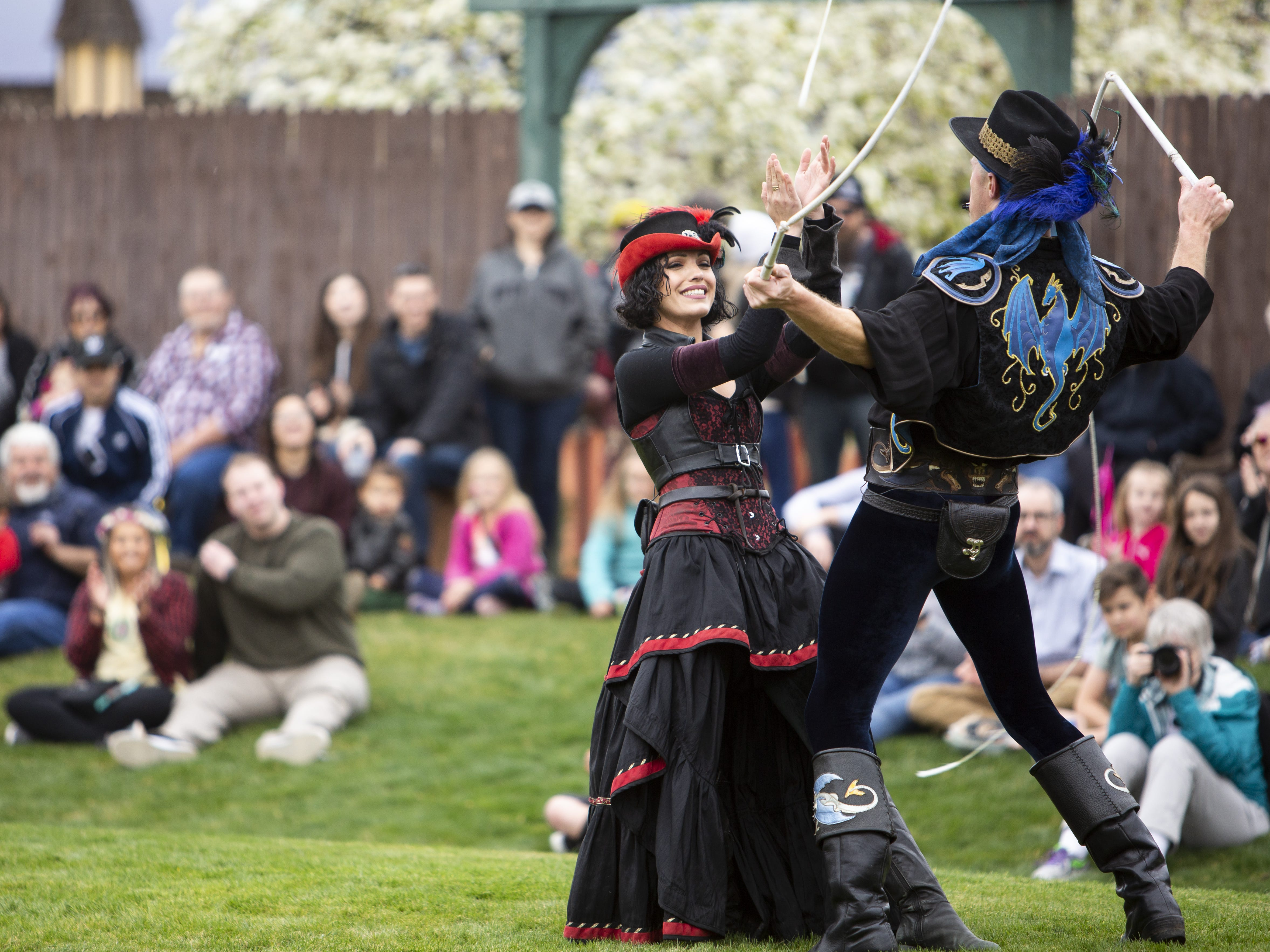 "Adam ""Crack"" Winrich and his wife Dakota Winrich, who goes by the stage name Esmeralda, perform together at the Arizona Renaissance Festival 2019 on Feb. 9, 2019 in Gold Canyon, Ariz."